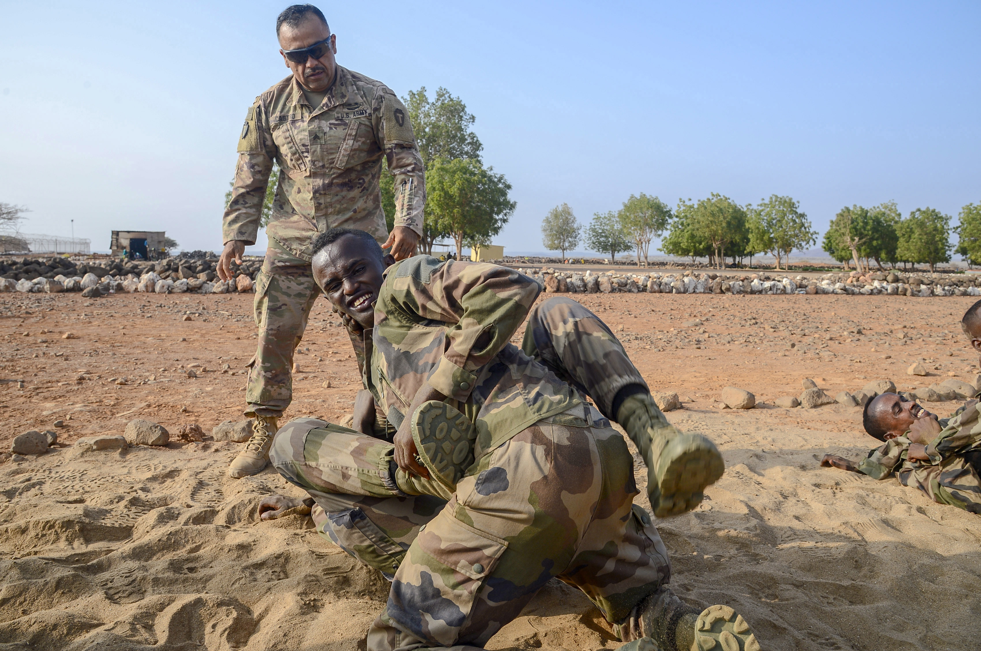 U.S. Army Sergeant Santiago Castro, Alpha Company, 3rd Battalion, 141st Infantry Regiment, Texas National Guard, trains Djiboutian Soldiers in U.S. Army Combatives at a training site outside Djibouti City, April 16, 2018. U.S. Army Combatives training is one of the courses for the Djiboutian Army's Rapid Intervention Battalion, a newly formed crisis response unit. (U.S. Navy Photo by Mass Communication Specialist 2nd Class Timothy M. Ahearn)