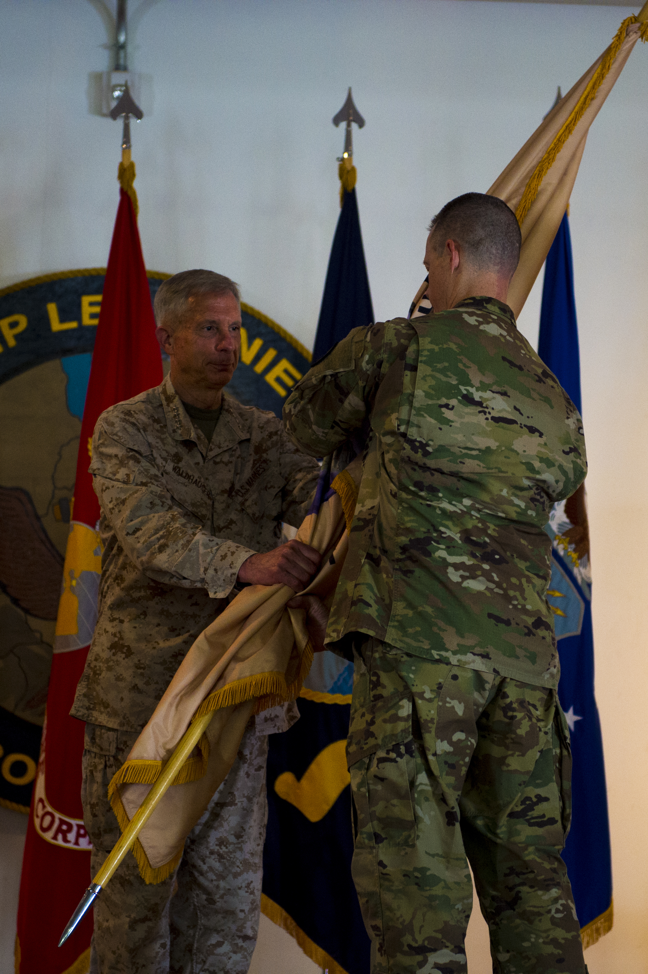 U.S. Marine Corps Gen. Thomas Waldhauser, Commander of United States Africa Command, passes the Combined Joint Task Force Horn of Africa flag, the symbol of command, to U.S. Army Brig. Gen. William Zana, the new CJTF-HOA acting commanding general, during the transfer of authority ceremony for CJTF-HOA on Camp Lemonnier, May 1, 2018.  (U.S. Air Force photo by Senior Airman Scott Jackson)