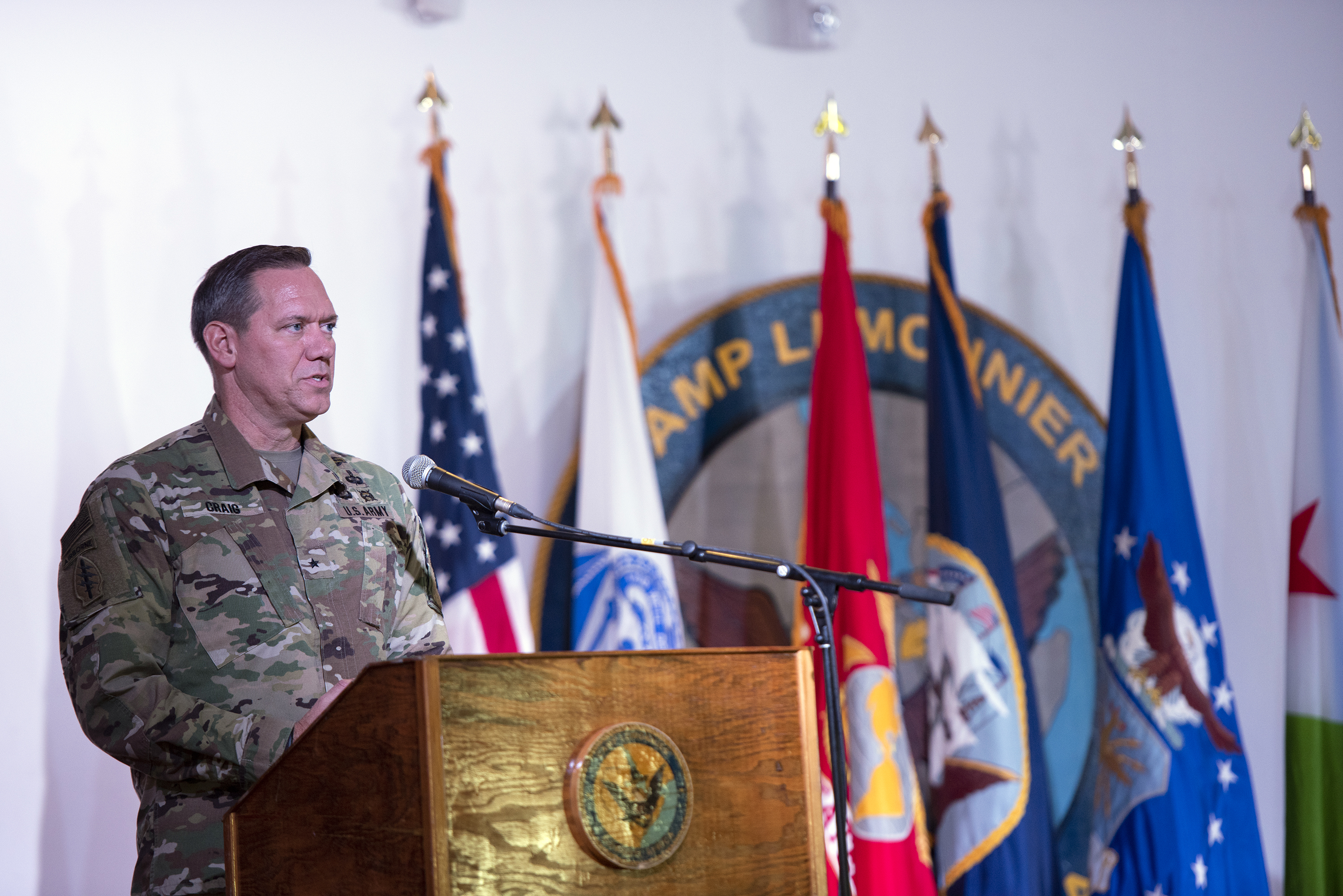 U.S. Army Brig. Gen. James Craig, commander, Combined Joint Task Force Horn of Africa, gives his welcome address following a change of command ceremony on Camp Lemonnier, Djibouti, June 14, 2018. Craig becomes the sixteenth commander of Combined Joint Task Force-Horn of Africa. (U.S. Air National Guard photo by Master Sgt. Sarah Mattison)