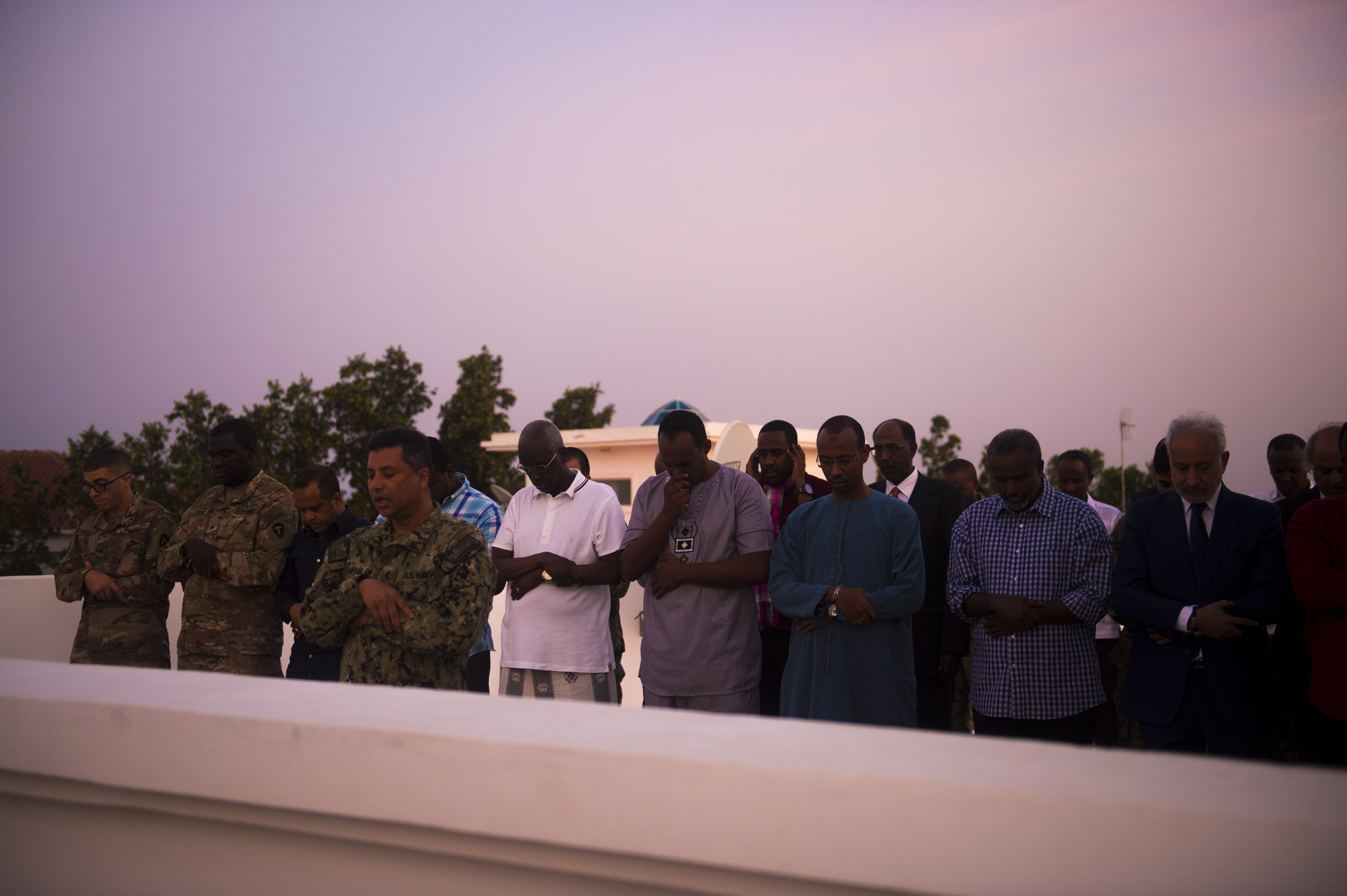 U.S. Navy Cmdr. Abduhena Saifulislam, chaplain, Africa Command, leads Muslims in prayer as the sun sets, beginning an Iftar at the residence of the U.S. Ambassador to the Republic of Djibouti, Larry André, May 22, 2018. André opened his home to celebrate two Iftars, one run by the Defense Attaché Office for senior Diboutian Military and security leaders, the second for senior government, diplomatic, and business leaders. (U.S. Air Force photo by Senior Airman Scott Jackson)