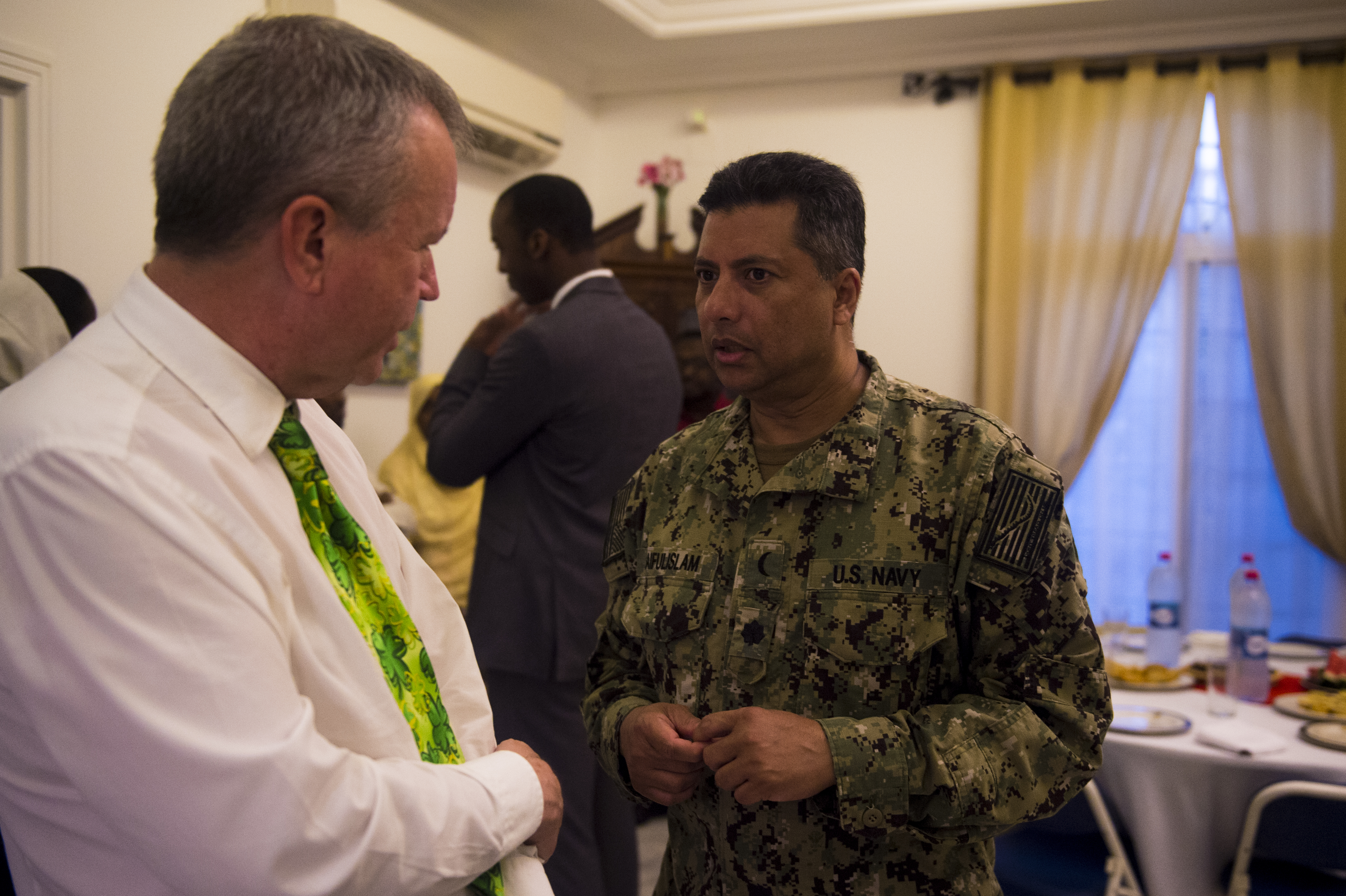 U.S. ambassador to the Republic of Djibouti Ambassador, Larry André, talks with U.S. Navy Cmdr. Abduhena Saifulislam, chaplain, Africa Command, during an Iftar celebration at André's home, Djibouti, May 22, 2018. André opened his home to celebrate two Iftars, one run by the Defense Attaché Office for senior Diboutian Military and security leaders, the second for senior government, diplomatic, and business leaders. (U.S. Air Force photo by Senior Airman Scott Jackson)
