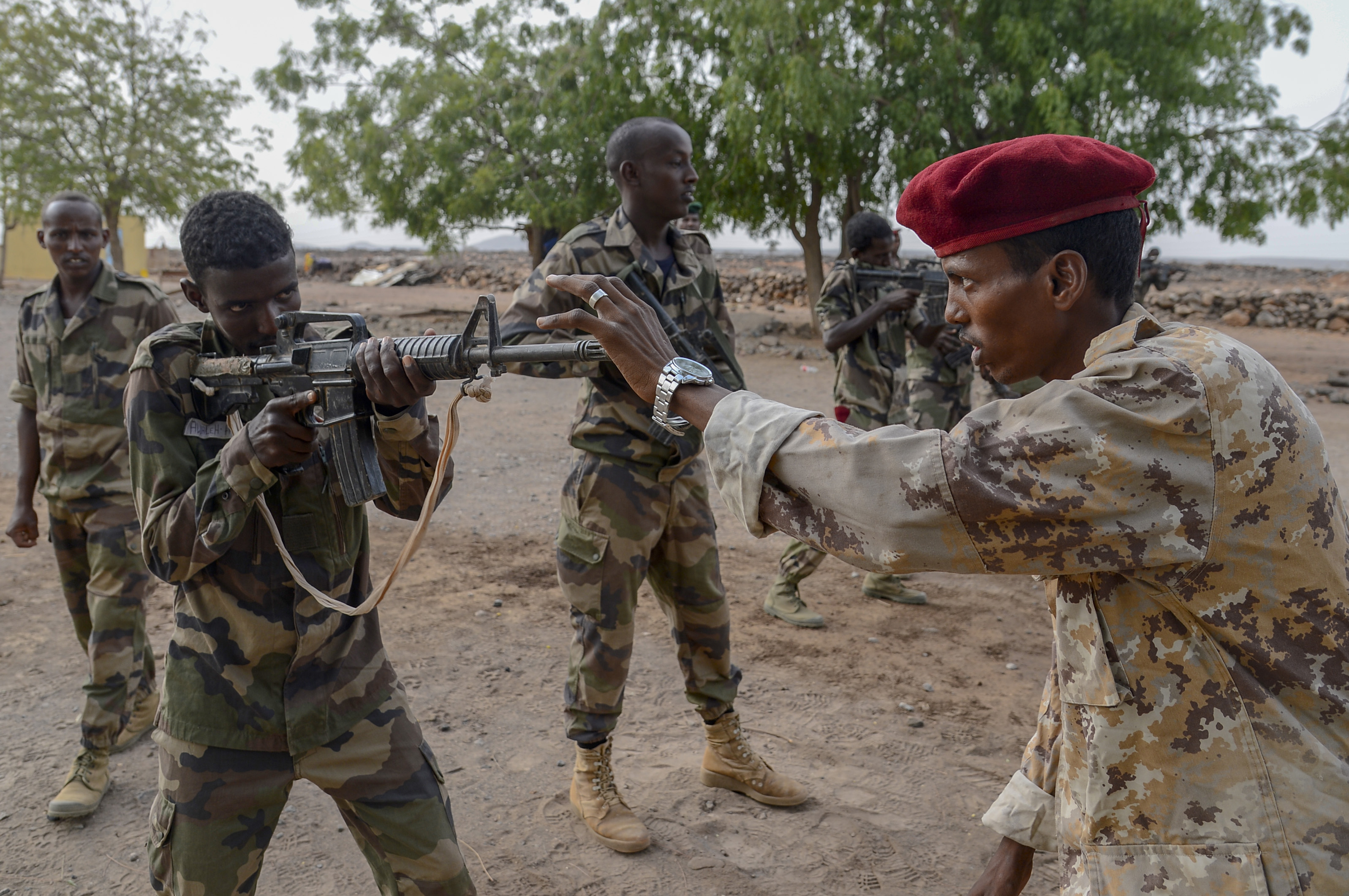 A non-commissioned officer with the Djiboutian Army's Rapid Intervention Battalion (RIB) instructs a new recruit at a training site outside Djibouti City, July 3, 2018. The RIB is a U.S. Army trained unit that was formed to respond to crises and promote regional security and stability in East Africa. (U.S. Navy Photo by Mass Communication Specialist 2nd Class Timothy M. Ahearn)
