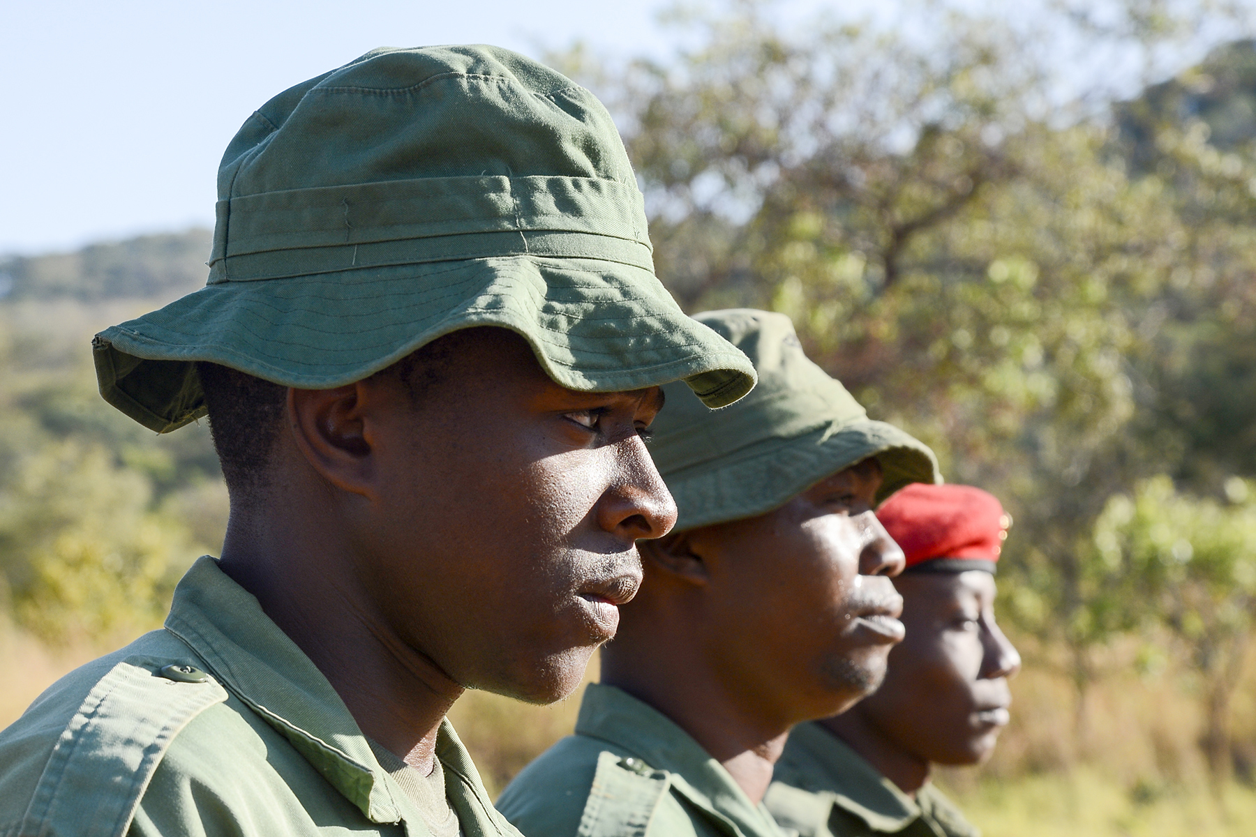 Tanzania Wildlife Management Authority (TAWA) patrol game wardens stand in formation for drill and ceremony training during a Counter Illicit Trafficking course, in Ngwala, Tanzania, July 24, 2018. The course provided by U.S. Army Soldiers with the 404th Civil Affairs Battalion, assigned to Combined Joint Task Force-Horn of Africa is a month-long course to enhance TAWA's anti-poaching capabilities in Tanzania. (U.S. Navy Photo by Mass Communication Specialist 2nd Class Timothy M. Ahearn)