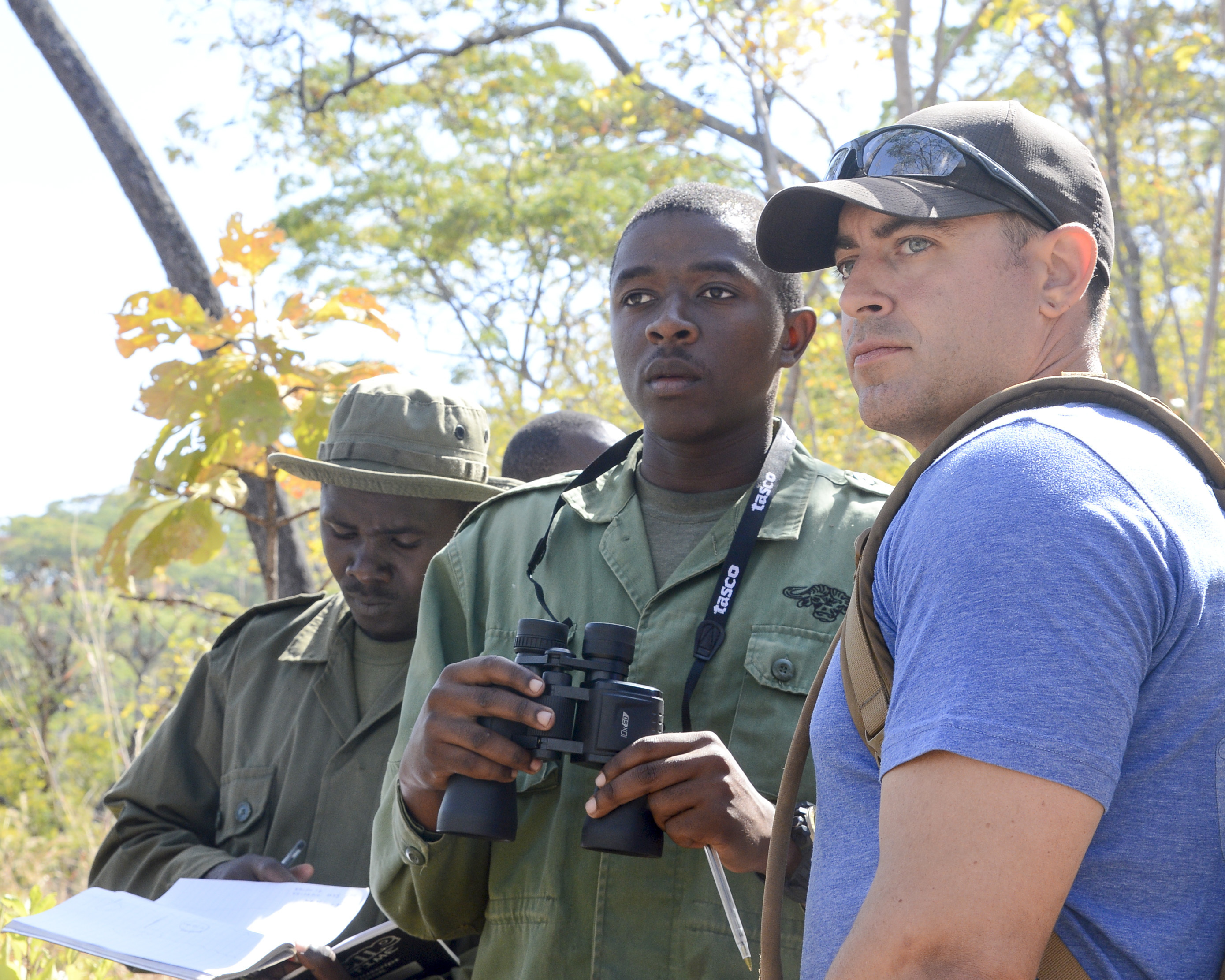 U.S. Army Staff Sgt. David Marcet, with the 404th Civil Affairs Battalion, assigned to Combined Joint Task Force-Horn of Africa, provides guidance during a ground surveillance practical exercise for Tanzania Wildlife Management Authority (TAWA) patrol game wardens during a Counter Illicit Trafficking course, in Ngwala, Tanzania, July 24, 2018. The course provided by  with the 404th Civil Affairs Battalion is a month-long course to enhance TAWA's anti-poaching capabilities in Tanzania. (U.S. Navy Photo by Mass Communication Specialist 2nd Class Timothy M. Ahearn)