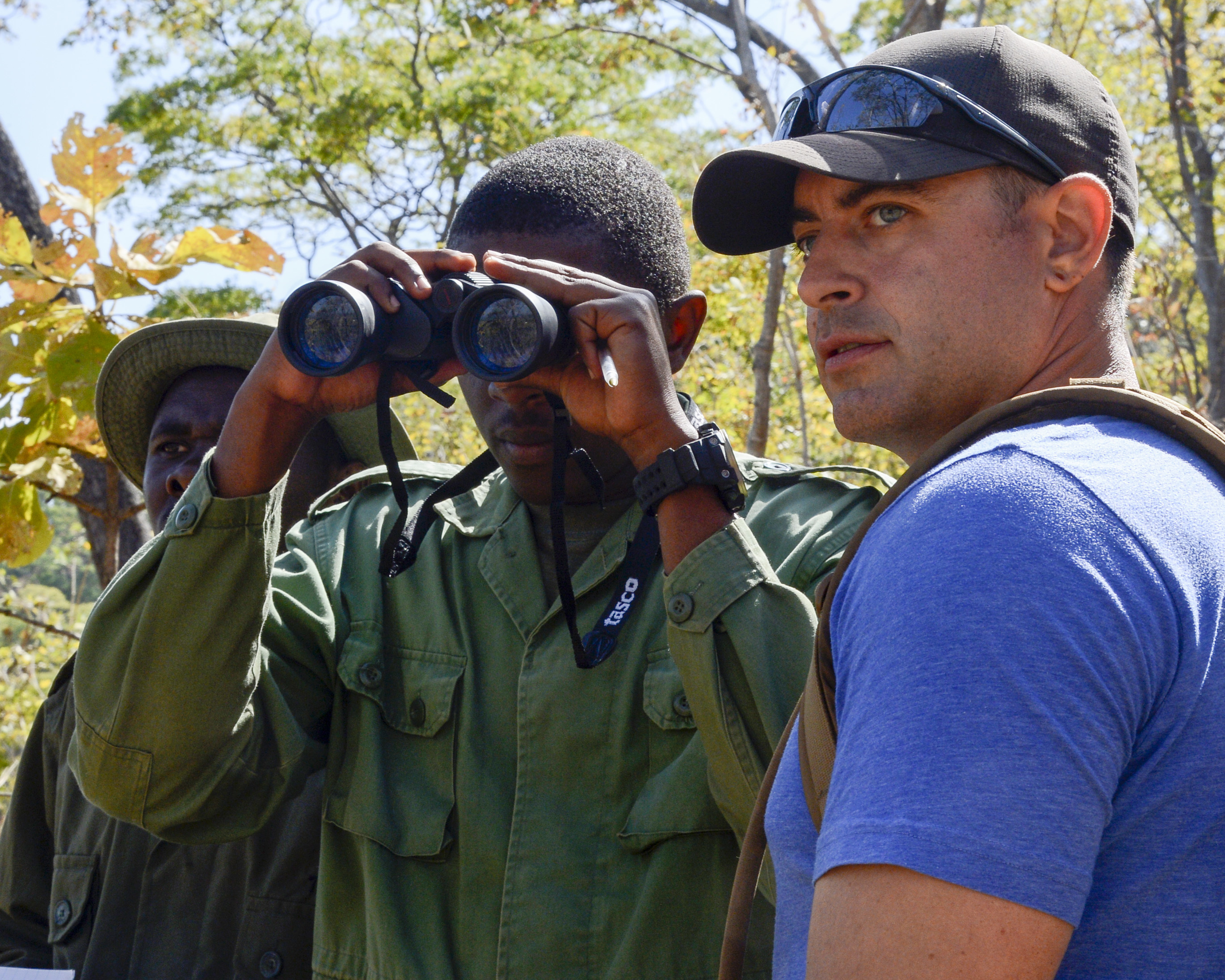U.S. Army Staff Sgt. David Marcet, with the 404th Civil Affairs Battalion, assigned to Combined Joint Task Force-Horn of Africa, provides guidance during a practical exercise in ground reconnaissance for Tanzania Wildlife Management Authority (TAWA) patrol game wardens during a Counter Illicit Trafficking course, in Ngwala, Tanzania, July 24, 2018. The course provided by the 404th Civil Affairs Battalion is a month-long course to enhance TAWA's anti-poaching capabilities in Tanzania. (U.S. Navy Photo by Mass Communication Specialist 2nd Class Timothy M. Ahearn)