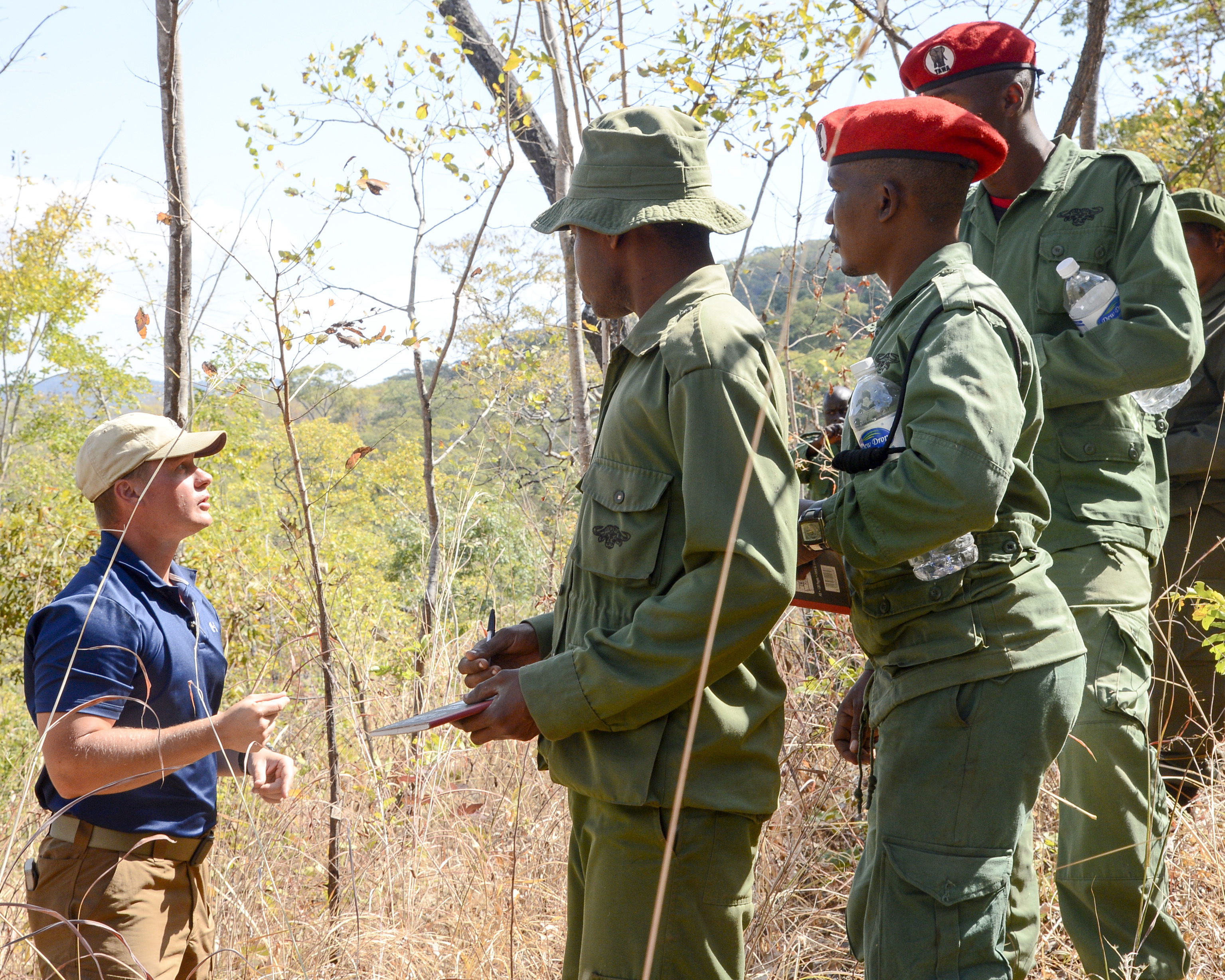 U.S. Army Maj. Kevin Jusza, with the 404th Civil Affairs Battalion, assigned to Combined Joint Task Force-Horn of Africa provides guidance for Tanzania Wildlife Management Authority (TAWA) patrol game wardens for a ground surveillance practical exercise during a Counter Illicit Trafficking course, in Ngwala, Tanzania, July 24, 2018. The course, provided by the 404th Civil Affairs Battalion, is a month-long course to enhance TAWA's anti-poaching capabilities in Tanzania. (U.S. Navy Photo by Mass Communication Specialist 2nd Class Timothy M. Ahearn)