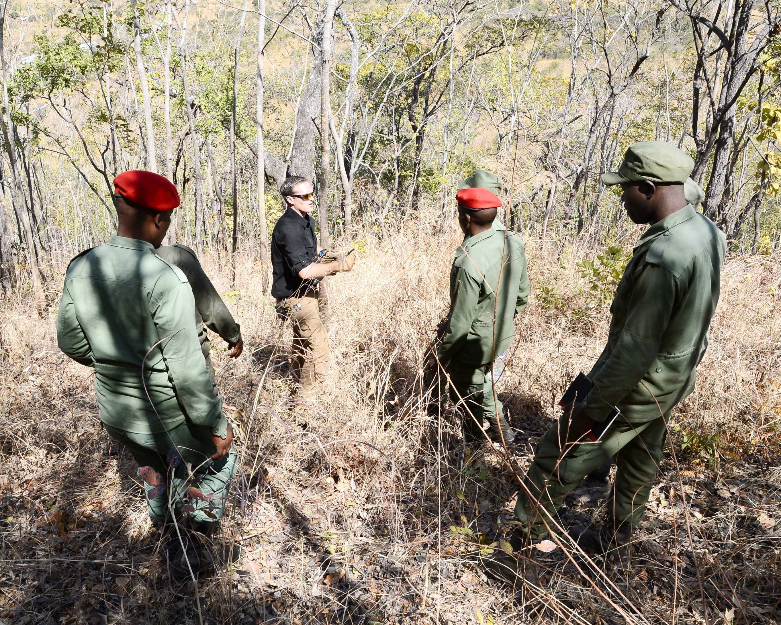 U.S. Army Sgt. Matthew Smith, with the 404th Civil Affairs Battalion, assigned to Combined Joint Task Force-Horn of Africa provides guidance during a practical exercise in ground reconnaissance for Tanzania Wildlife Management Authority (TAWA) patrol game wardens during a Counter Illicit Trafficking course, in Ngwala, Tanzania, July 24, 2018. The course, provided the 404th Civil Affairs Battalion, is a month-long course to enhance TAWA's anti-poaching capabilities in Tanzania. (U.S. Navy Photo by Mass Communication Specialist 2nd Class Timothy M. Ahearn)