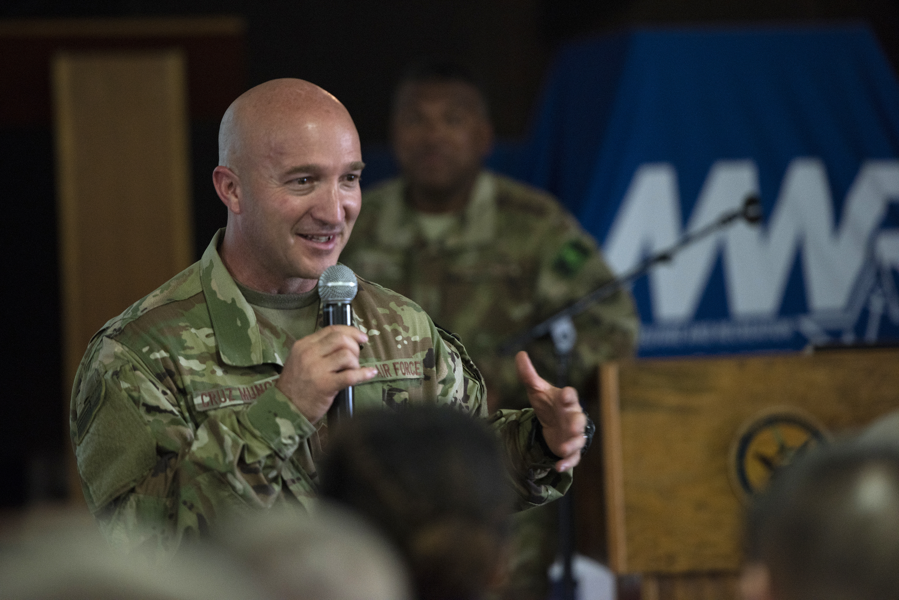 U.S. Air Force Chief Master Sgt. Anthony Cruz Munoz, command chief, 3rd Air Force, speaks to Airmen from the 449th Air Expeditionary Group on Camp Lemonnier, Djibouti, Aug. 18, 2018. Cruz Munoz and Lt. Gen. Richard Clark, commander, 3rd Air Force, participated in a question-and-answer session and shared their leadership perspectives with the deployed service members. (U.S. Air National Guard photo by Master Sgt. Sarah Mattison)