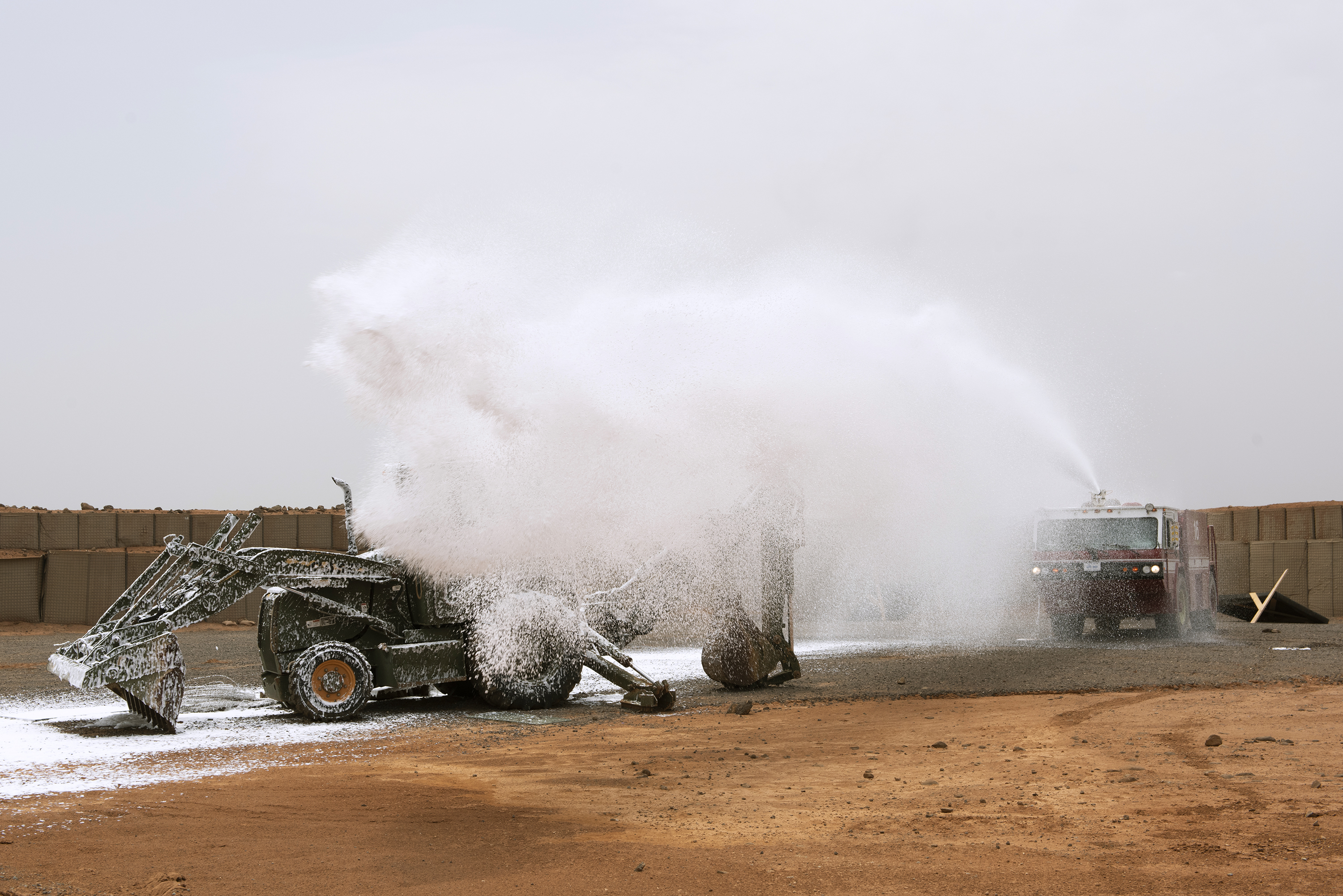 U.S. Air Force firefighters with the 449th Air Expeditionary Group and Combined Joint Task Force Horn of Africa use a P-19B fire truck to fight a simulated fire during training, outside Djibouti City, Djibouti, Aug. 20, 2018. The Airmen continually perform scenario based training tasks in order to maintain their skills. (U.S. Air National Guard photo by Master Sgt. Sarah Mattison)
