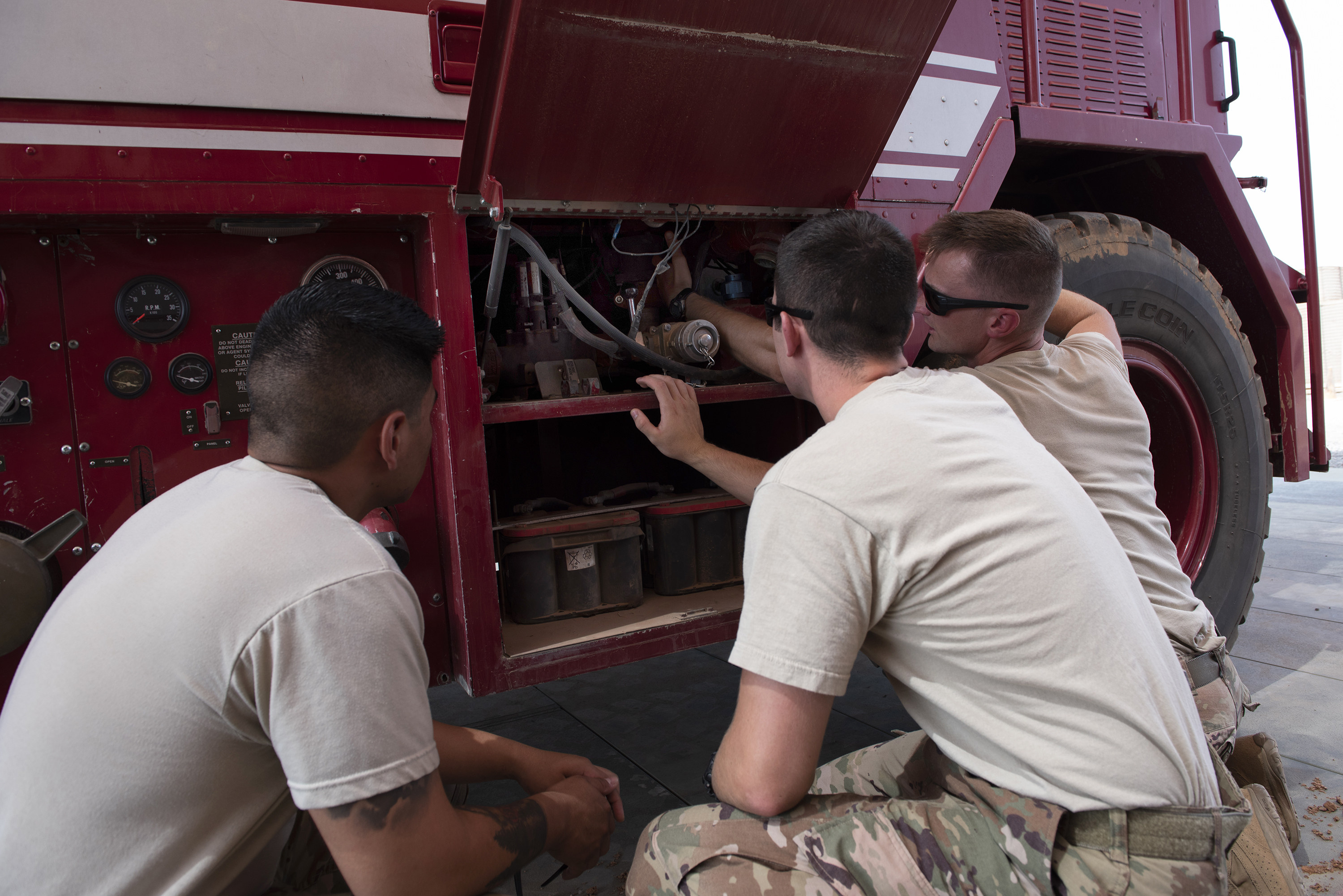 U.S. Air Force firefighters with the 449th Air Expeditionary Group and Combined Joint Task Force Horn of Africa conduct proficiency training on a P-19B fire truck, outside Djibouti City, Djibouti, Aug. 20, 2018. The Airmen continually perform scenario based training tasks in order to maintain their skills. (U.S. Air National Guard photo by Master Sgt. Sarah Mattison)