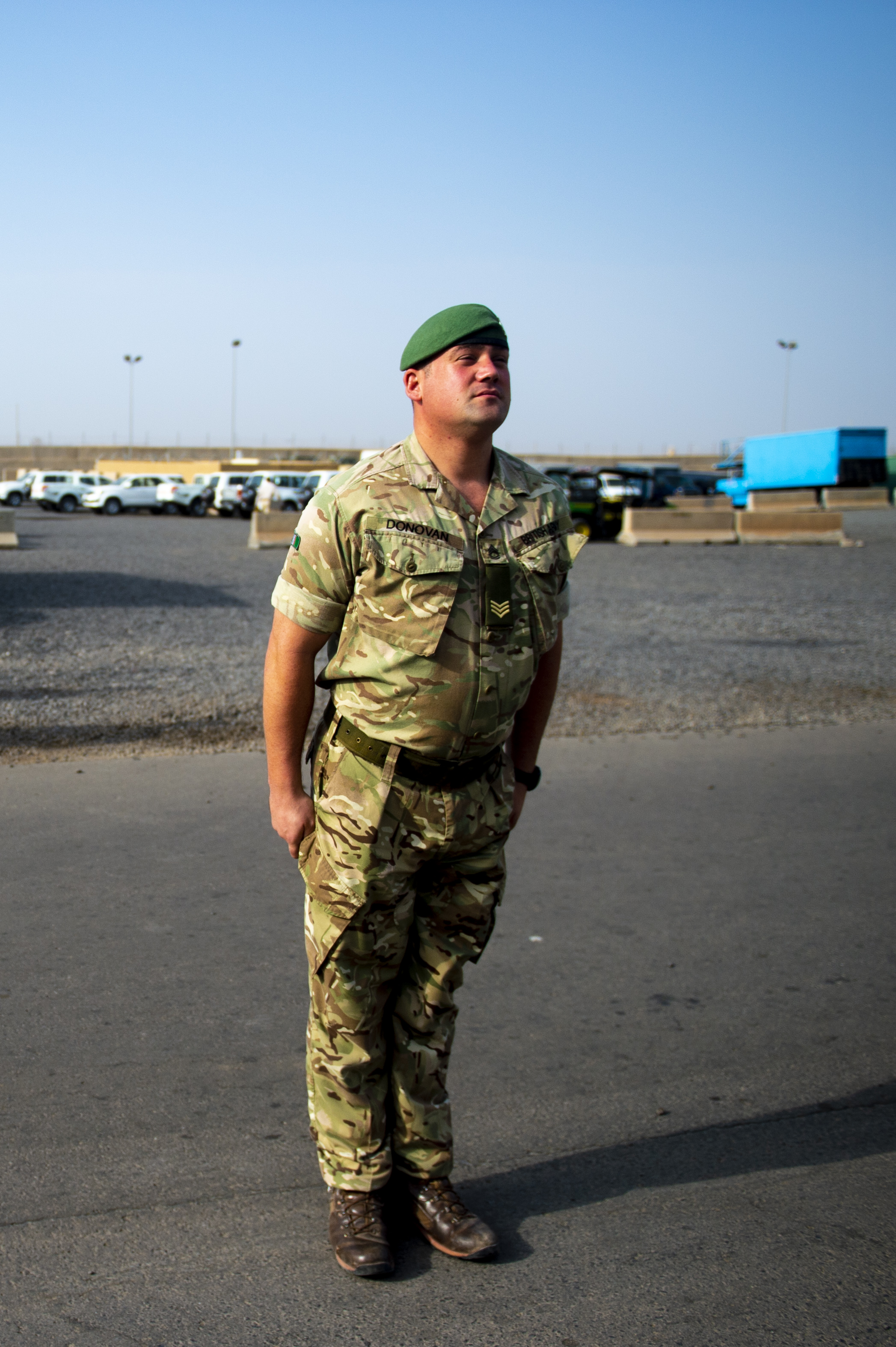British Army Sgt. David Donovan leads a color detail for morning colors on Camp Lemonnier, Djibouti, August 25, 2018. Donovan volunteered to lead the detail to learn more about America military tradition. He is currently serving the United States as an exchange officer. (U.S. Air Force photo by Senior Airman Scott Jackson)