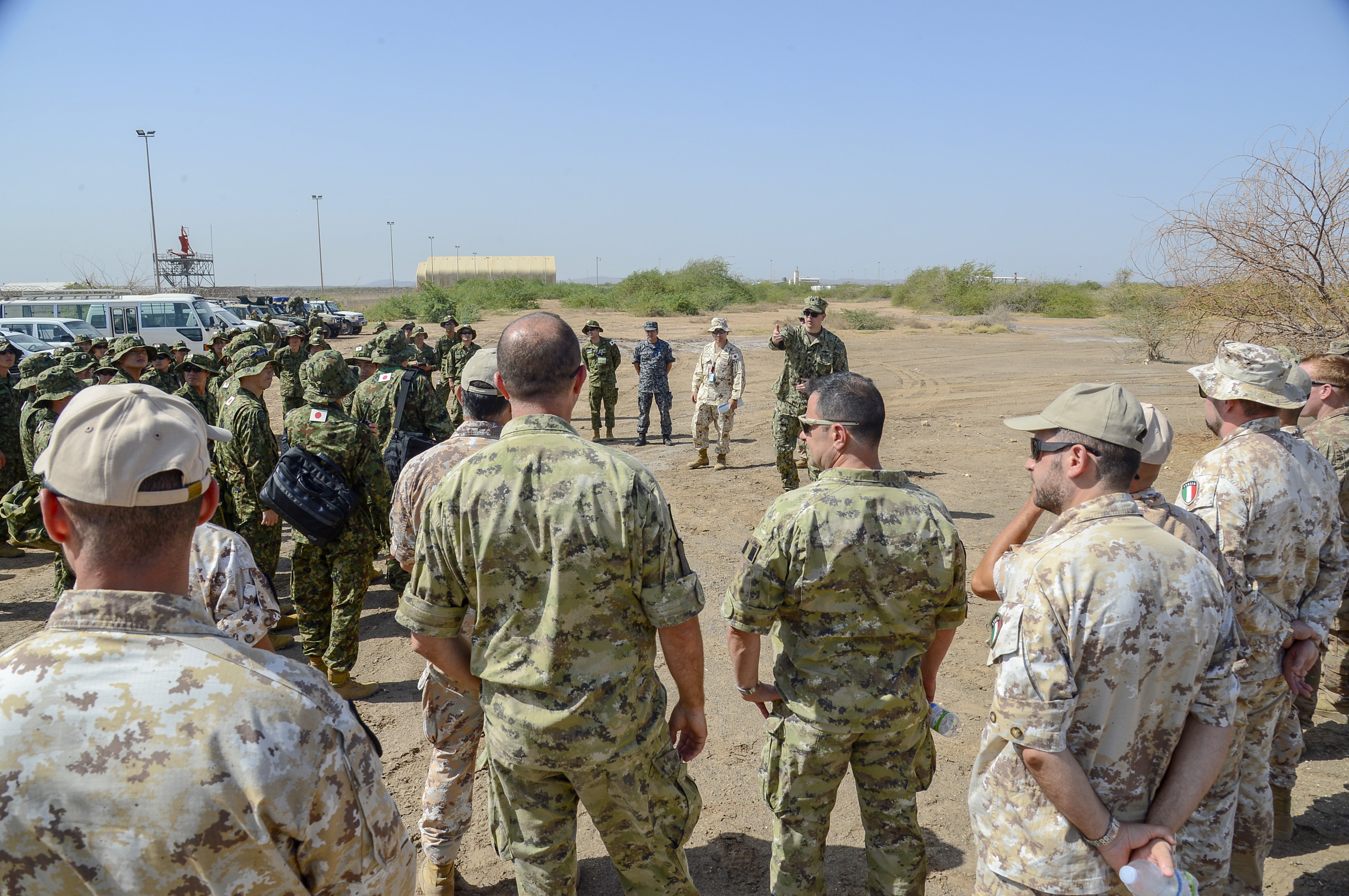 U.S. Army and coalition partners receive a brief on convoy evacuation operations during a joint coalition exercise at Camp Lemonnier, Djibouti, Sep. 5, 2018. The joint exercise allowed coalition forces from Italy, Japan, France, and Djibouti to learn alongside the U.S. Army and exchane best practices. (U.S. Navy Photo by Mass Communication Specialist 2nd Class Timothy M. Ahearn)