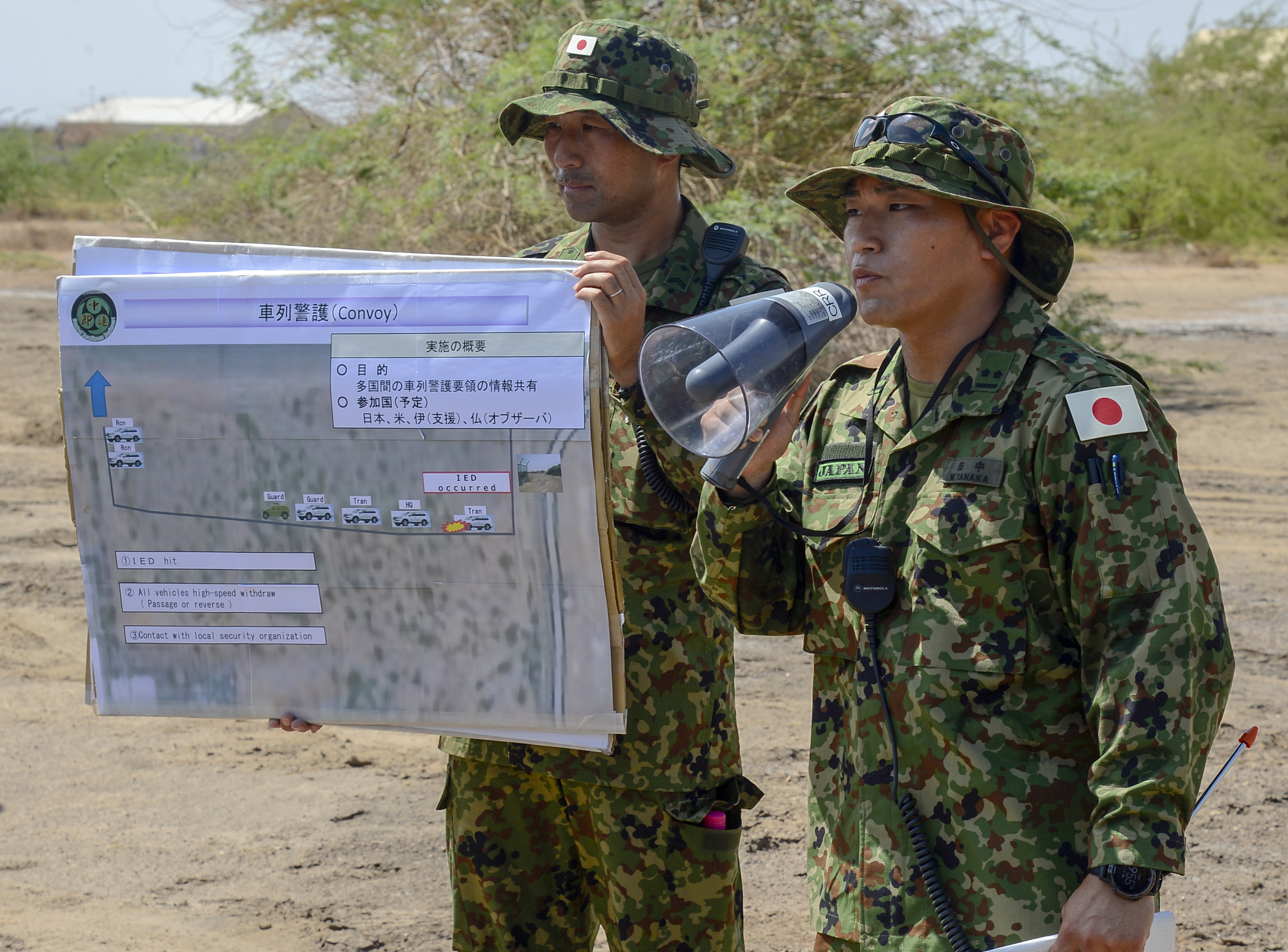 Japanese Self Defense Force 1st Lt. Masaki Tanaka presents a brief on Japanese convoy evacuation operations during a joint coalition exercise at Camp Lemonnier, Djibouti, Sep. 5, 2018. The joint exercise allowed coalition forces from Italy, Japan, France, and Djibouti to learn alongside the U.S. Army and exchane best practices. (U.S. Navy Photo by Mass Communication Specialist 2nd Class Timothy M. Ahearn)
