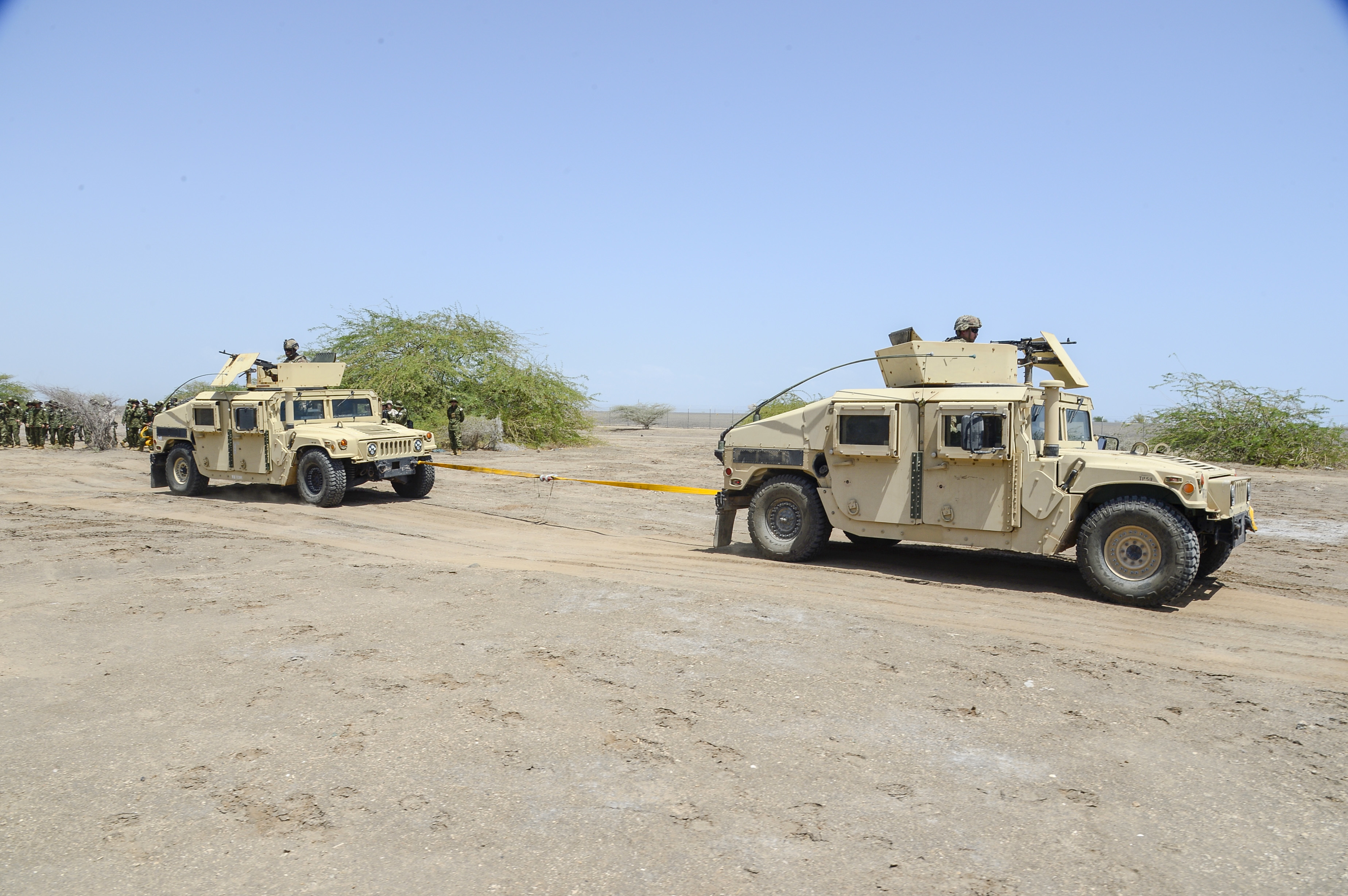 U.S. Army Soldiers conduct convoy evacuation operations in Humvees during a joint coalition exercise at Camp Lemonnier, Djibouti, Sep. 5, 2018. The joint exercise allowed coalition forces from Italy, Japan, France, and Djibouti to learn alongside the U.S. Army and exchane best practices. (U.S. Navy Photo by Mass Communication Specialist 2nd Class Timothy M. Ahearn)