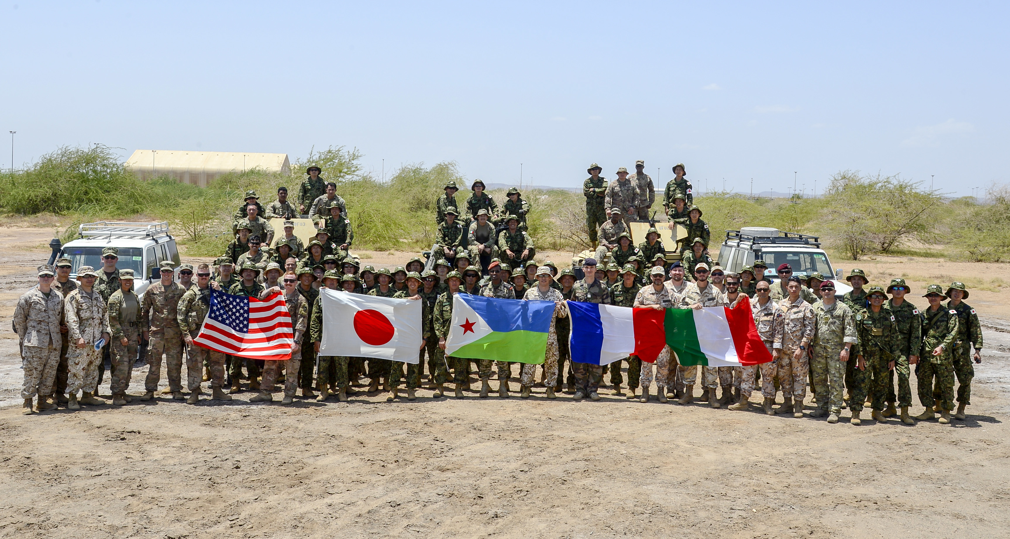 U.S. and coalition forces pose for a group photo following a joint coalition exercise at Camp Lemonnier, Djibouti, Sep. 5, 2018. The joint exercise allowed coalition forces from Italy, Japan, France, and Djibouti to learn alongside the U.S. Army and exchane best practices. (U.S. Navy Photo by Mass Communication Specialist 2nd Class Timothy M. Ahearn)