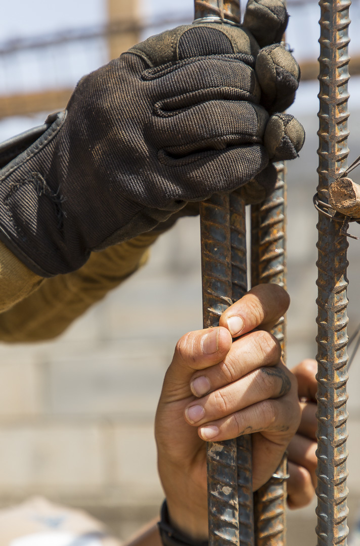 U.S. Navy Seabees from Naval Mobile Construction Battalion 1, Detachment Horn of Africa (NMCB 1 Det-HOA) hold rebar in place as they tie it together at Ali Oune, Djibouti, Sept. 19, 2018. NMCB 1, Det-HOA is building a medical facility in support of the Ministry of Health for Djibouti to provide medical aid to locals in need. (U.S. Air National Guard photo by Master Sgt. Andrew Sinclair)