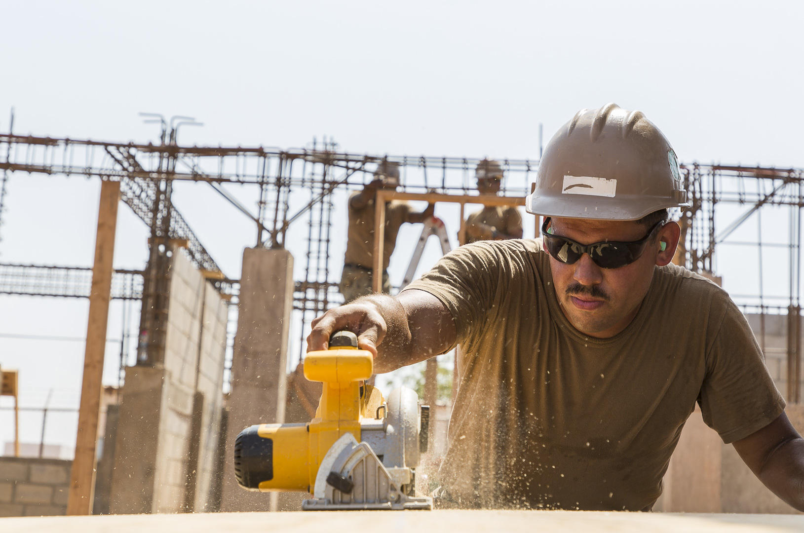 U.S. Navy Equipment Operator 1st Class Ryan Bright, a Seabee assigned to Naval Mobile Construction Battalion 1 Detachment Horn of Africa (NMCB 1 Det HOA) cuts plywood for living quarters at Ali Oune, Djibouti, Sept. 19, 2018. Seabees with NMCB 1 Det-HOA are building a medical facility in Ali Oune in support of the Ministry of Health for Djibouti. (U.S. Air National Guard photo by Master Sgt. Andrew Sinclair)