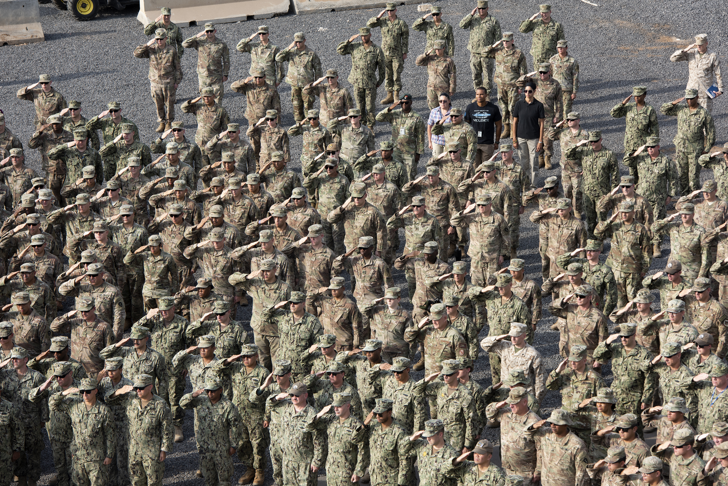 U.S. Service members deployed to the Horn of Africa salute during a 9/11 remembrance ceremony on Camp Lemonnier, Djibouti, Sept. 11, 2018. The ceremony honored those who lost their lives in New York City, Washington D.C. and Pennsylvania 17 years ago. (U.S. Air National Guard photo by Master Sgt. Sarah Mattison)