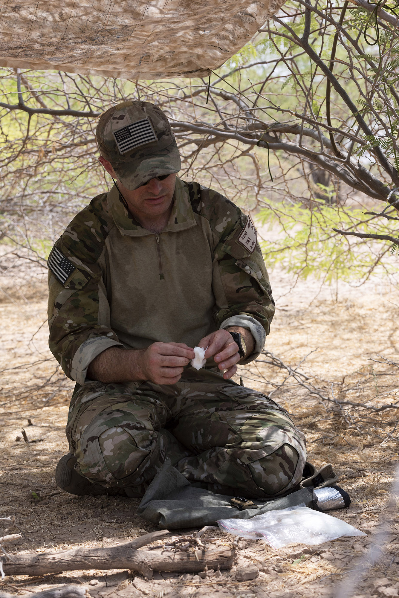 U.S. Air Force Tech. Sgt. Adam Murphy, a survival, evasion, resistance and escape specialist assigned to Combined Joint Task Force-Horn of Africa, demonstrates how to start a fire during survival skills training on Camp Lemonnier, Djibouti, Oct. 13, 2018. During this training, Murphy gave instruction on various skills such as constructing a shelter, finding alternative water sources and signaling for rescue. (U.S. Air National Guard photo by Master Sgt. Sarah Mattison)