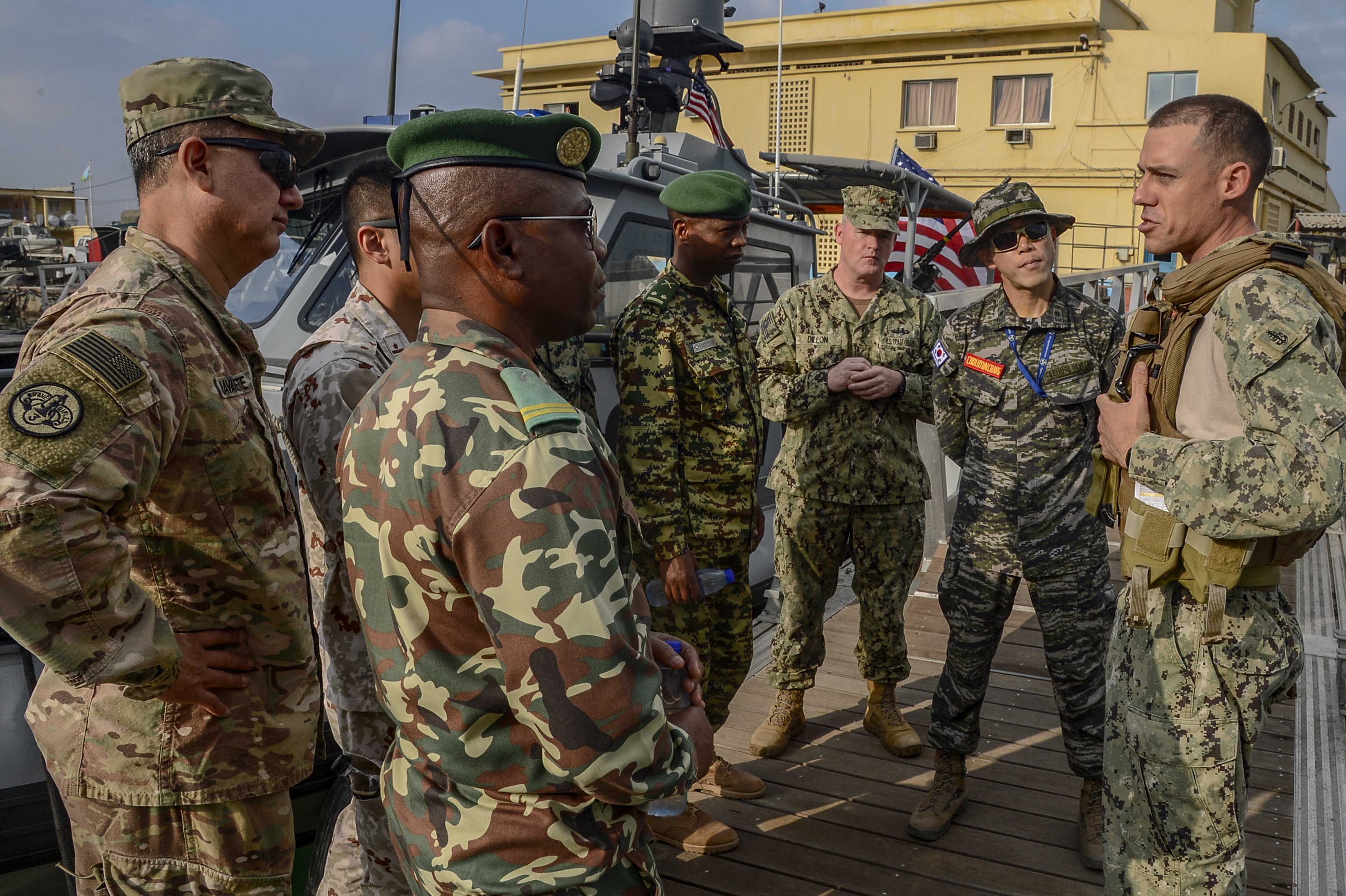 Foreign Liaison Officers (FLOs), assigned to Combined Joint Task Force-Horn of Africa (CJTF-HOA), receive a safety brief prior to observing maritime security operations (MSO) with Coastal Riverine Squadron (CRS) 8 at the Port of Djibouti, Oct. 23, 2018.  The CJTF-HOA FLOs observed the operations to better understand MSO and the CRS-8 mission. (U.S. Navy photo by Mass Communication Specialist 2nd Class Timothy M. Ahearn)