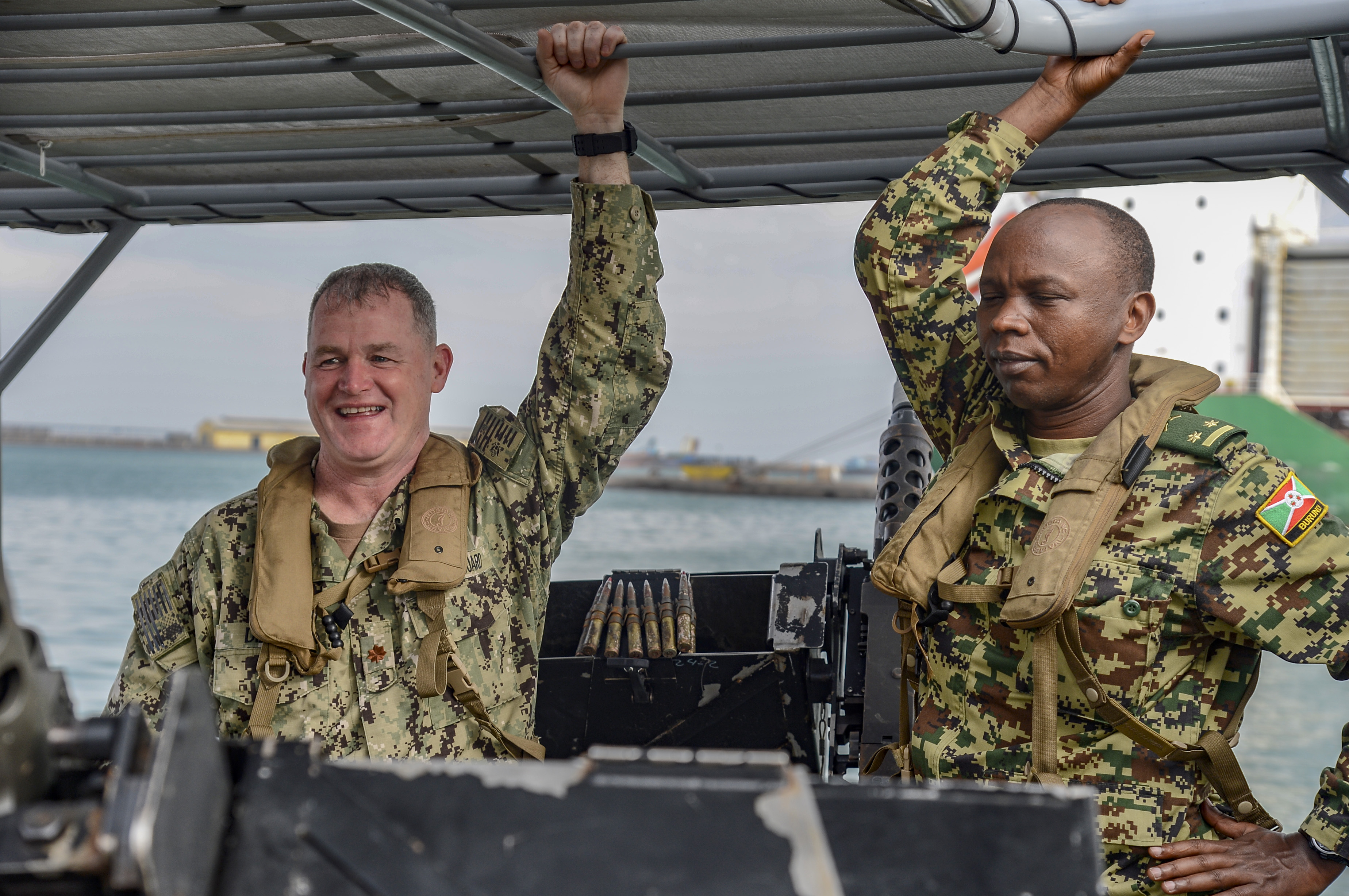 U.S. Coast Guard Lt. Cmdr. Patrick Dillon, deputy commander of Coastal Riverine Squadron (CRS) 8, and Burundi Army Lt. Col. Desire Manirakiza, a foreign liaison officer (FLO) with Combined Joint Task Force-Horn of Africa, prepare to embark for maritime security operations (MSO) at the Port of Djibouti, Oct. 23, 2018. CJTF-HOA FLOs observed the operations to better understand MSO and the CRS-8 mission. (U.S. Navy photo by Mass Communication Specialist 2nd Class Timothy M. Ahearn)