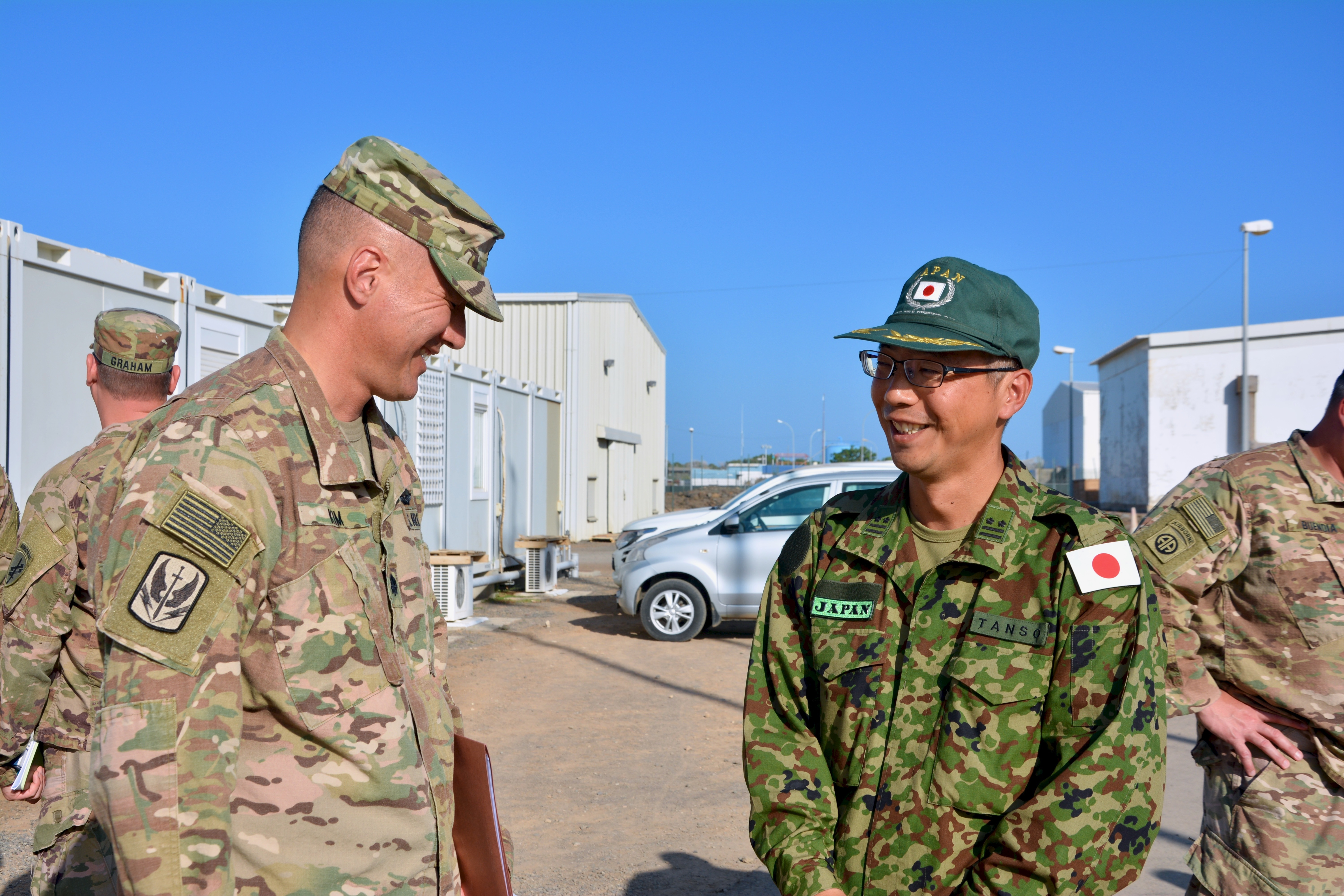 U.S. Army Lt. Col. Kenneth Kim, commander of the 403rd Civil Affairs Battalion, Mattydale, New York, greets Japan Ground Self-Defense Force Col. Masatoshi Tanso during a key leadership engagement at Japan Self-Defense Force Base, Djibouti, Nov. 21, 2018. Japanese and U.S. leadership met to discuss ways to build relationships across the Combined Joint Operations Area. (U.S. Army Photo by Capt. Olivia Cobiskey)