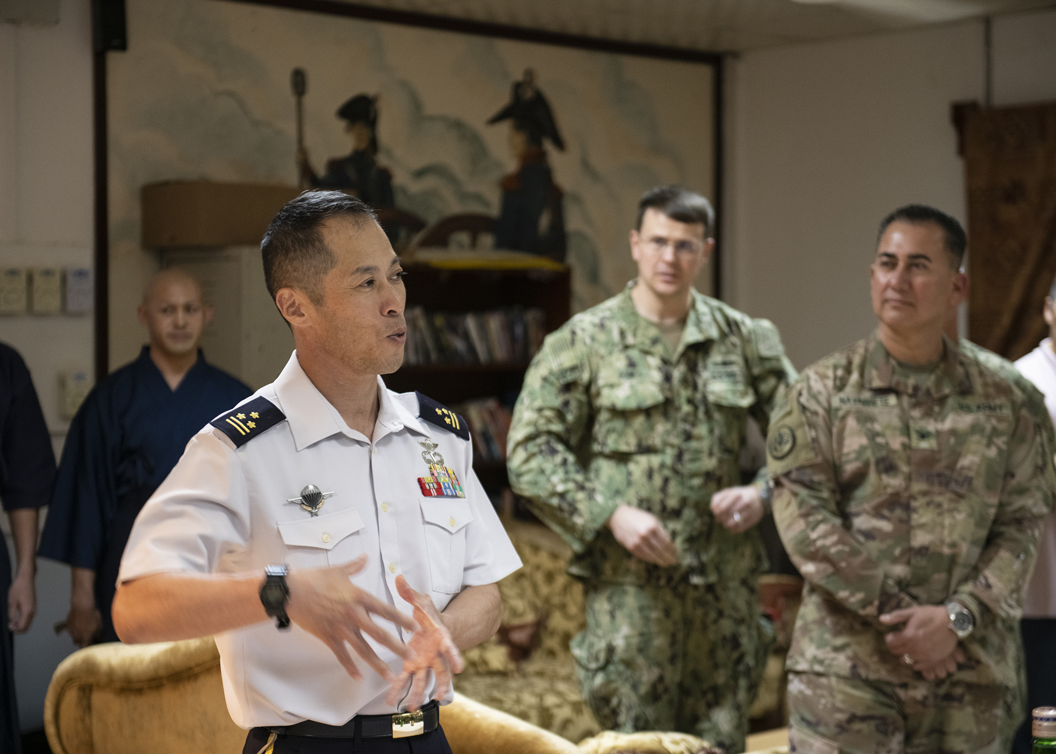 Japan Ground Self-Defense Force Col. Takuro Sekiya, commander of Deployment Support Group Counter-Piracy Enforcement, gives opening remarks at a cultural exchange event led by Japan Ground Self-Defense Force leadership at Camp Lemonnier, Djibouti, Nov. 28, 2018. Multinational military partners affiliated with Camp Lemonnier hold monthly exchange events to strengthen alliances and attract new partners in the combined joint military environment. (U.S. Air Force photo by Tech. Sgt. Shawn Nickel)