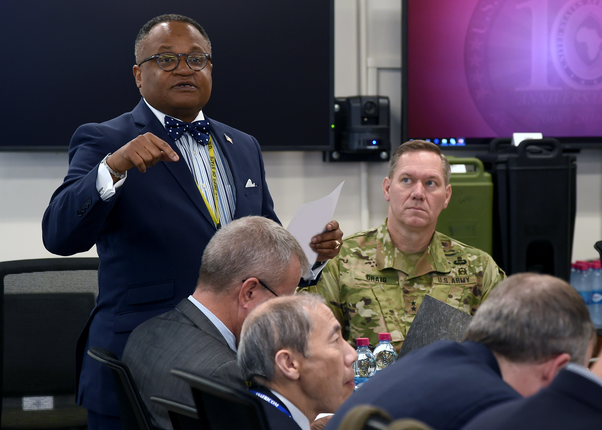 Irvin Hicks Jr., foreign policy advisor (POLAD) for Combined Joint Task Force-Horn of Africa (CJTF-HOA), addresses U.S. diplomats and joint service personnel at a meeting during the CJTF-HOA East Africa Security Forum (EASF) at Camp Lemonnier, Djibouti, Dec. 13, 2018. The EASF provides opportunities for CJTF-HOA and interagency leaders to assess and align efforts, and develop synchronized courses of action that support common goals. (U.S. Navy photo by Mass Communication Specialist 1st Class Nick Scott)