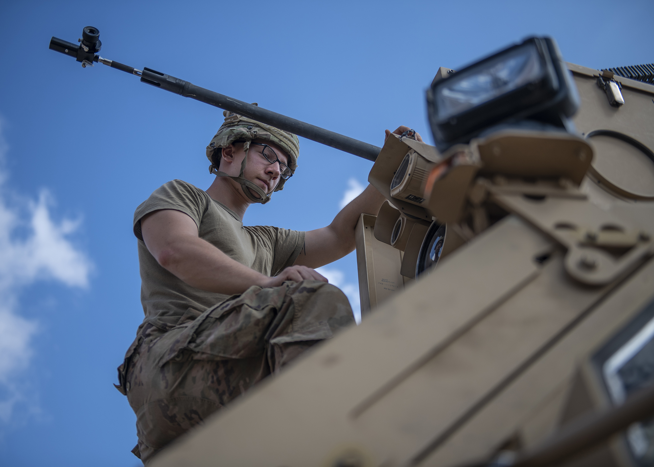 U.S. Army Spc. Kaleb Steffens, gunner, Delta Company, 4th Platoon, 1st Battalion 141st Infantry Regiment Task Force Alamo, Texas National Guard, deployed to Combined Joint Task Force-Horn of Africa (CJTF-HOA), Djibouti, prepares a .50-caliber Common Remotely Operated Weapon Station on top of a Mine-Resistant Ambush-Protected vehicle during training at a military range in Djibouti, Dec. 15, 2018. Task Force Alamo is responsible for rapidly deploying in response to any crisis threatening U.S. personnel or property throughout CJTF-HOA, an area nearly half the size of the continental United States. (U.S. Air Force photo by Tech. Sgt. Shawn Nickel)