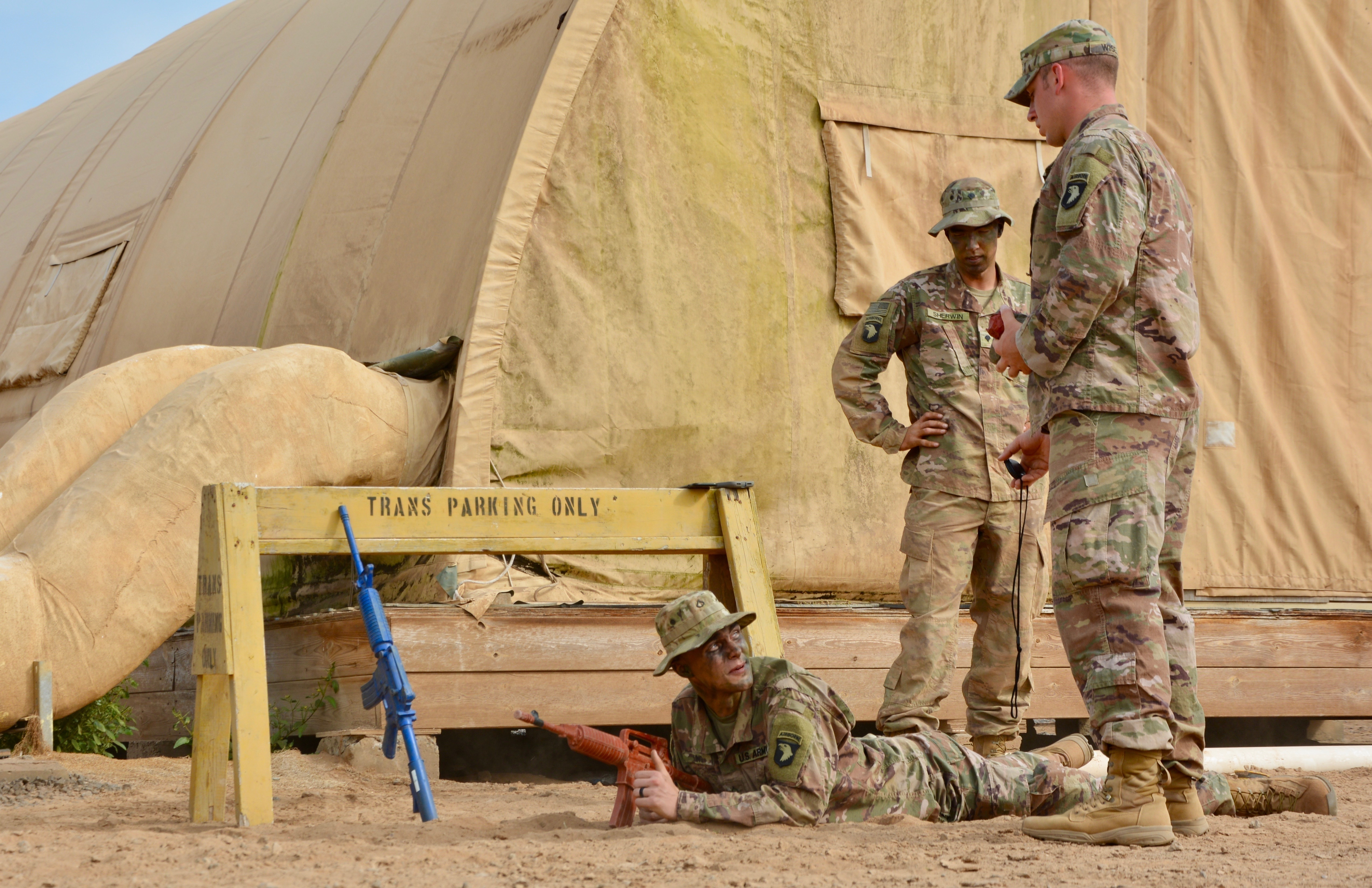 U.S. Army Staff Sgt. Tyler Wisely, assigned to Bravo Company, 1st Battalion, 26th Infantry Regiment, 101st Airborne Division, shows his Soldier the '00' on the stopwatch before testing him on his ability to disable a bunker with a hand grenade during training for the Expert Infantryman Badge at Camp Lemonnier, Djibouti, Dec. 18, 2018. Members of the Fort Campbell, Kentucky unit demonstrated a mastery of critical skills that reinforce their ability to respond to emergency situations at U.S. Embassies in the East African region as members of the Combined Joint Task Force-Horn of Africa (CJTF-HOA), East Africa Response Force (EARF).