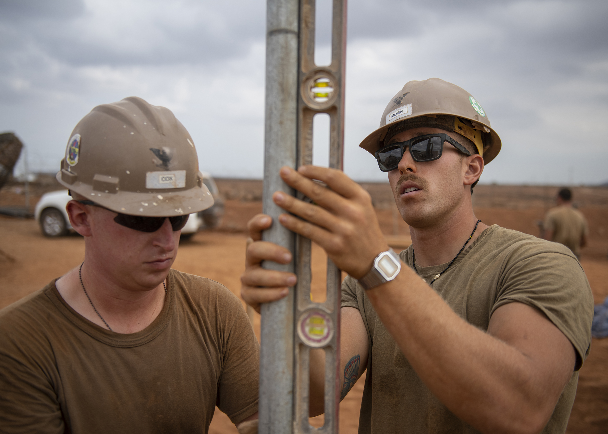 U.S. Navy Petty Officer 3rd Class Austin Cox, left, and Michael Morin, Seabees assigned to Naval Mobile Construction Battalion 1, Combined Joint Task Force-Horn of Africa, Camp Lemonnier, Djibouti, build a fence during the construction of the future Ali Oune, Djibouti, Women's Medical Clinic, Dec. 27, 2018. The clinic is intended to enhance the Ministry of Health for Djibouti's ability to provide basic medical, birth and after care to the Ali Oune village and its more than 1,000 residents and rural neighbors. (U.S. Air Force photo by Tech. Sgt. Shawn Nickel)