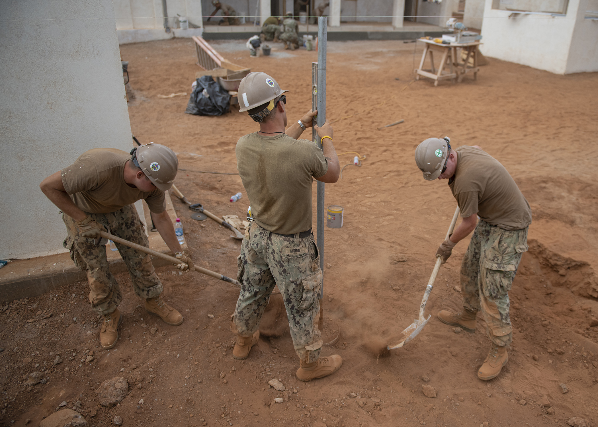 U.S. Navy Seabees assigned to Naval Mobile Construction Battalion 1, Combined Joint Task Force-Horn of Africa, Camp Lemonnier, Djibouti, build a fence during the construction of the future Ali Oune, Djibouti, Women's Medical Clinic, Dec. 27, 2018. The clinic is intended to enhance the Ministry of Health for Djibouti's ability to provide basic medical, birth and after care to the Ali Oune village and its more than 1,000 residents and rural neighbors. (U.S. Air Force photo by Tech. Sgt. Shawn Nickel)