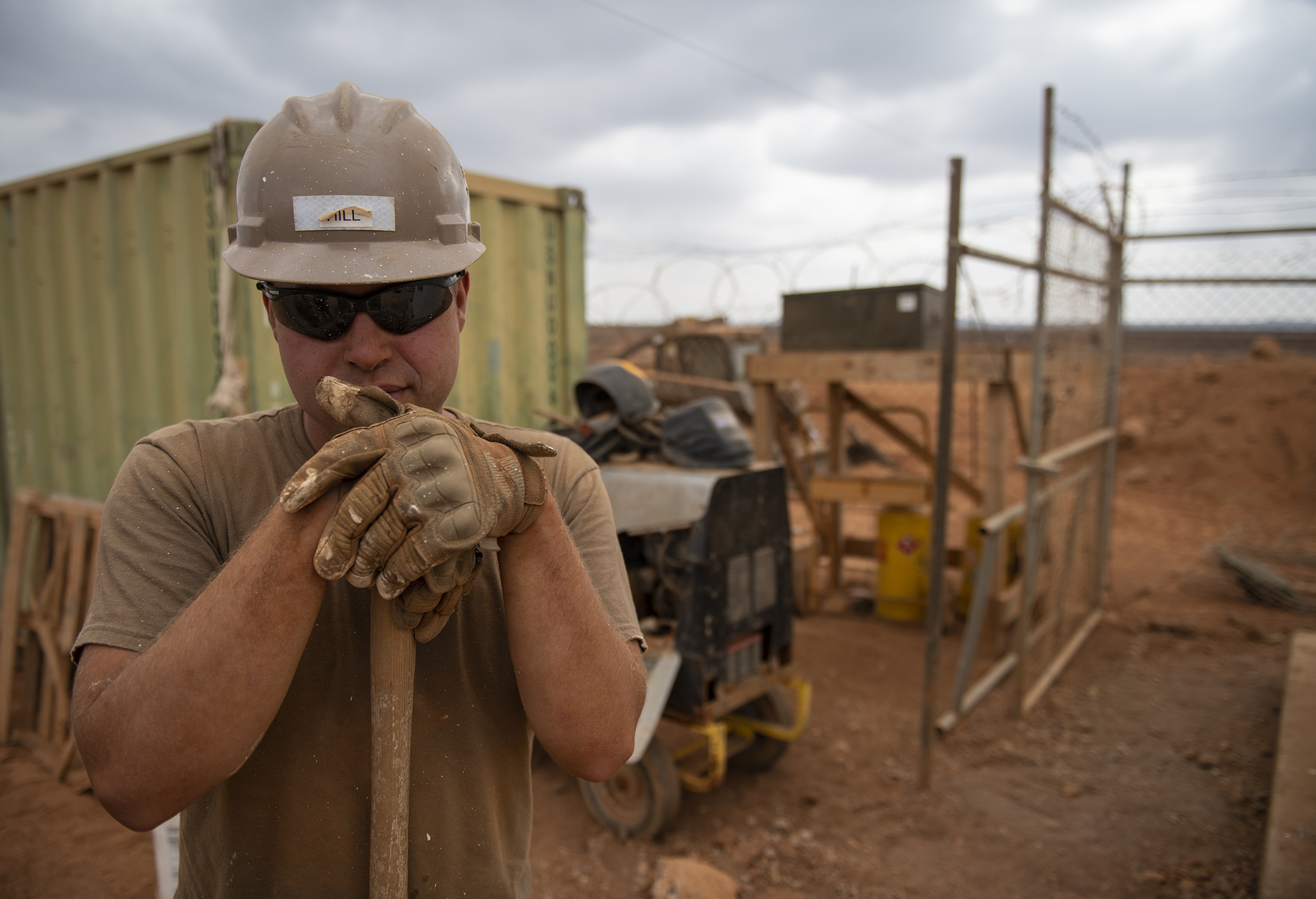 U.S. Navy Seaman Tyler Hill, a Seabee assigned to Naval Mobile Construction Battalion 1, Combined Joint Task Force-Horn of Africa, Camp Lemonnier, Djibouti, builds a fence during the construction of the future Ali Oune, Djibouti, Women's Medical Clinic, Dec. 27, 2018. The clinic is intended to enhance the Ministry of Health for Djibouti's ability to provide basic medical, birth and after care to the Ali Oune village and its more than 1,000 residents and rural neighbors. (U.S. Air Force photo by Tech. Sgt. Shawn Nickel)