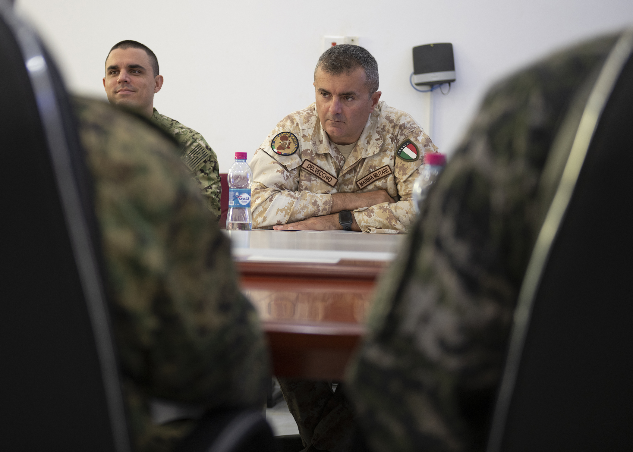 Italian Marina Militare Lt. Col. Alex Delecchio, a foreign liaison officer (FLO) assigned to Combined Joint Task Force-Horn of Africa (CJTF-HOA), listens during the first-ever formal meeting between FLOs and U.S. military members assigned to CJTF-HOA, and officials from the Intergovernmental Authority on Development in Djibouti, Jan. 16, 2019. The purpose of the meeting was for both parties to familiarize themselves with each other's missions and goals through a short information exchange and set the stance for future meetings. (U.S. Air Force photo by Tech. Sgt. Shawn Nickel)
