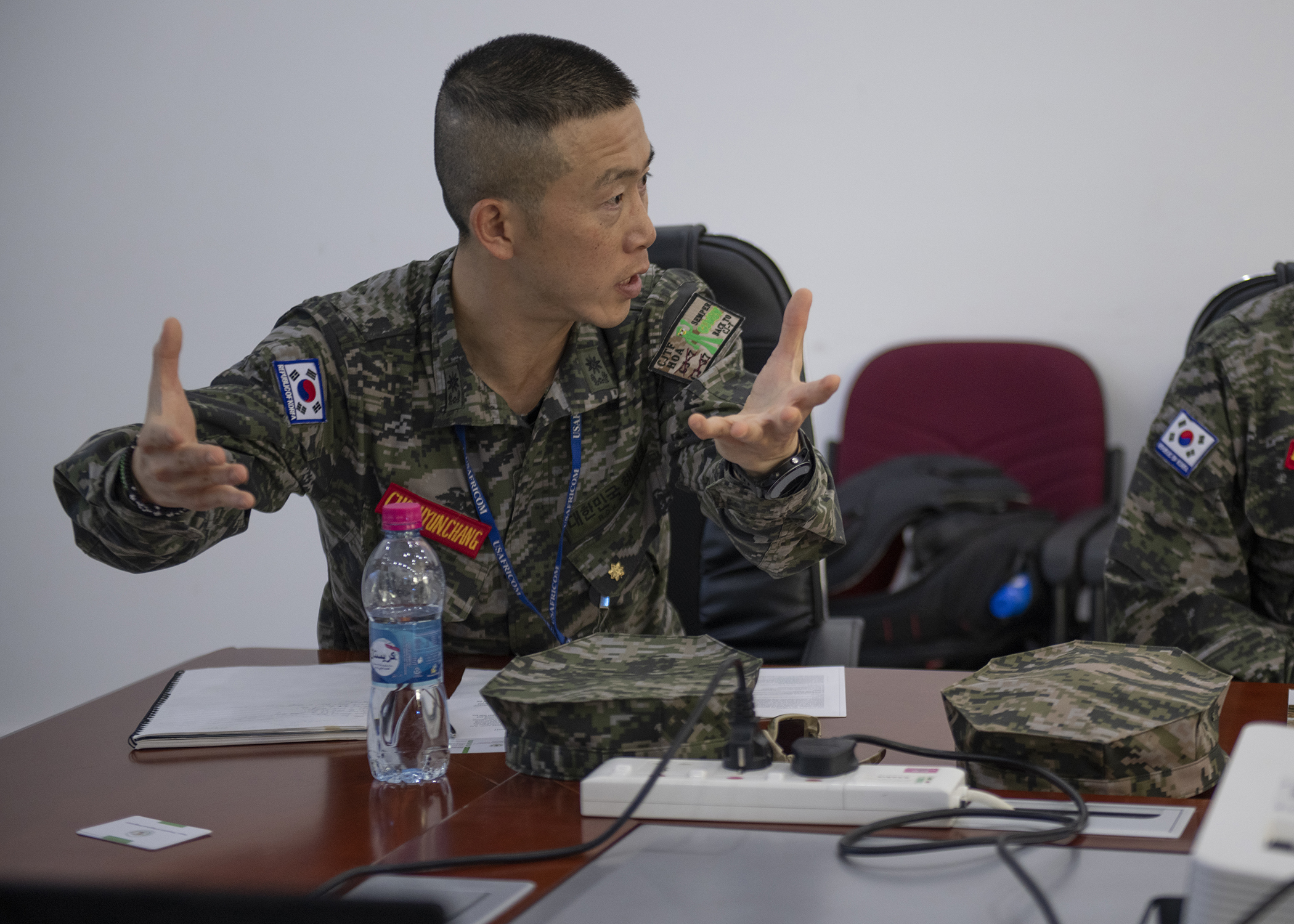 Republic of Korea Marine Maj. Hyunchang Choi, a foreign liaison officer (FLO) assigned to Combined Joint Task Force-Horn of Africa (CJTF-HOA), starts a discussion during the first-ever formal meeting between FLOs and U.S. military members assigned to CJTF-HOA, and officials from the Intergovernmental Authority on Development in Djibouti, Jan. 16, 2019. The purpose of the meeting was for both parties to familiarize themselves with each other's missions and goals through a short information exchange and set the stance for future meetings. (U.S. Air Force photo by Tech. Sgt. Shawn Nickel)