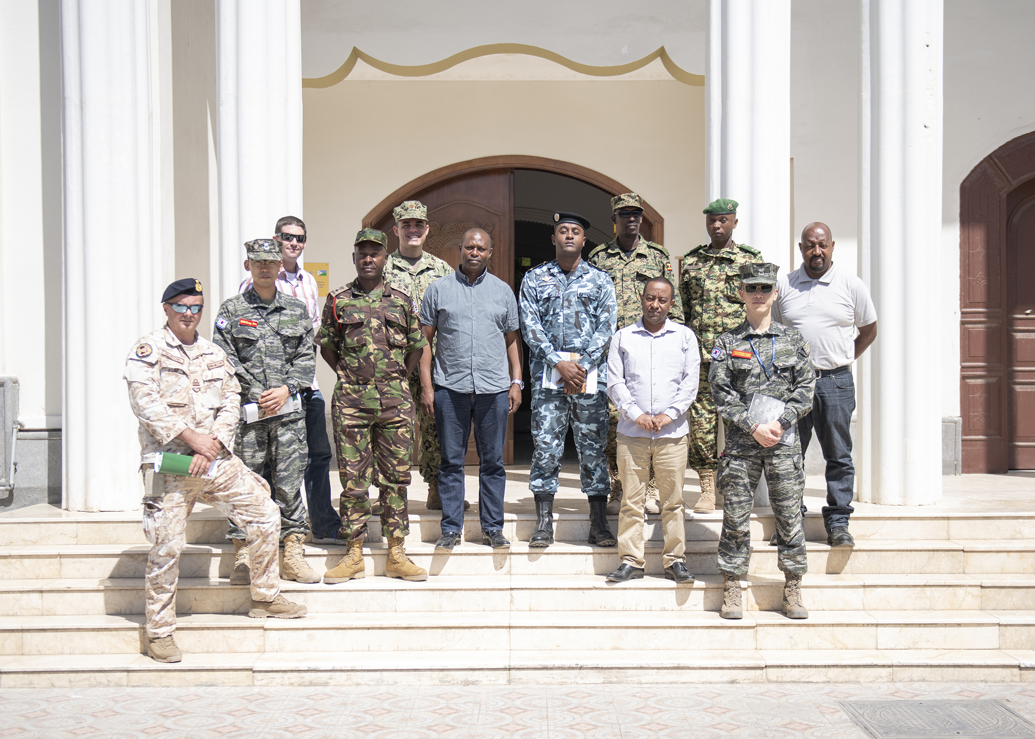 Foreign Liaison Officers and U.S. military members assigned to Combined Joint Task Force-Horn of Africa, and officials from the Intergovernmental Authority on Development pose for a photo during their first-ever formal meeting in Djibouti, Jan. 16, 2019. The purpose of the meeting was for both parties to familiarize themselves with each other's missions and goals through a short information exchange and set the stance for future meetings. (U.S. Air Force photo by Tech. Sgt. Shawn Nickel)