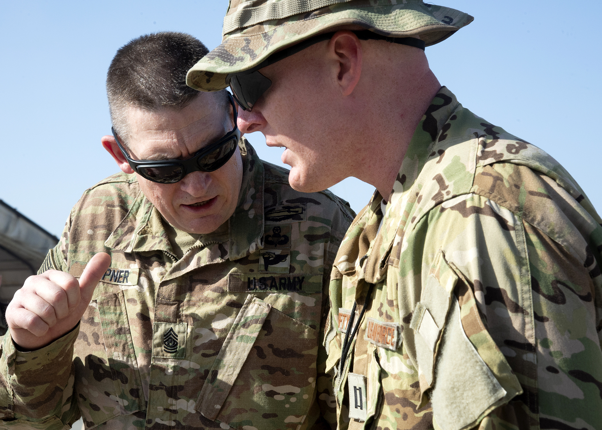 U.S. Army Command Sgt. Maj. Christopher Kepner, command sergeant major of the National Guard Bureau, speaks to U.S. Air Force Capt. Michael Hefty, director of operations, 12th Expeditionary Special Operations Squadron, on the flight line at Chabelley Airfield, Djibouti, Jan. 17, 2019. Kepner visited National Guardsmen deployed to Combined Joint Task Force-Horn of Africa Jan. 15-19, 2019. (U.S. Air Force photo by Master Sgt. Amanda Currier)