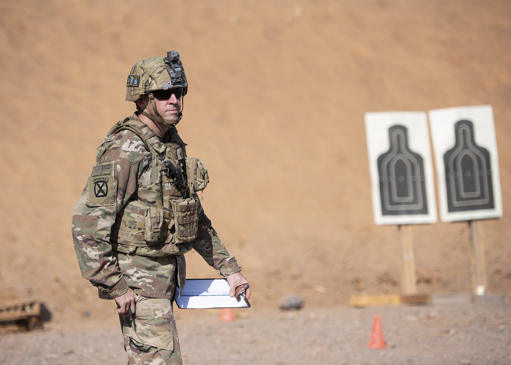 A U.S. Army Soldier from 1-141 Infantry Regiment, Task Force Alamo, Texas National Guard, assigned to Combined Joint Task Force-Horn of Africa, officiates the official marksmanship portion of the German Armed Forces Badge for military proficiency at the Arta Range Complex, Djibouti, Jan. 17, 2019. Competing for the badge offered a unique opportunity to Soldiers and worked as an information exchange between the U.S. and Germany militaries. (U.S. Air Force photo by Tech. Sgt. Shawn Nickel)