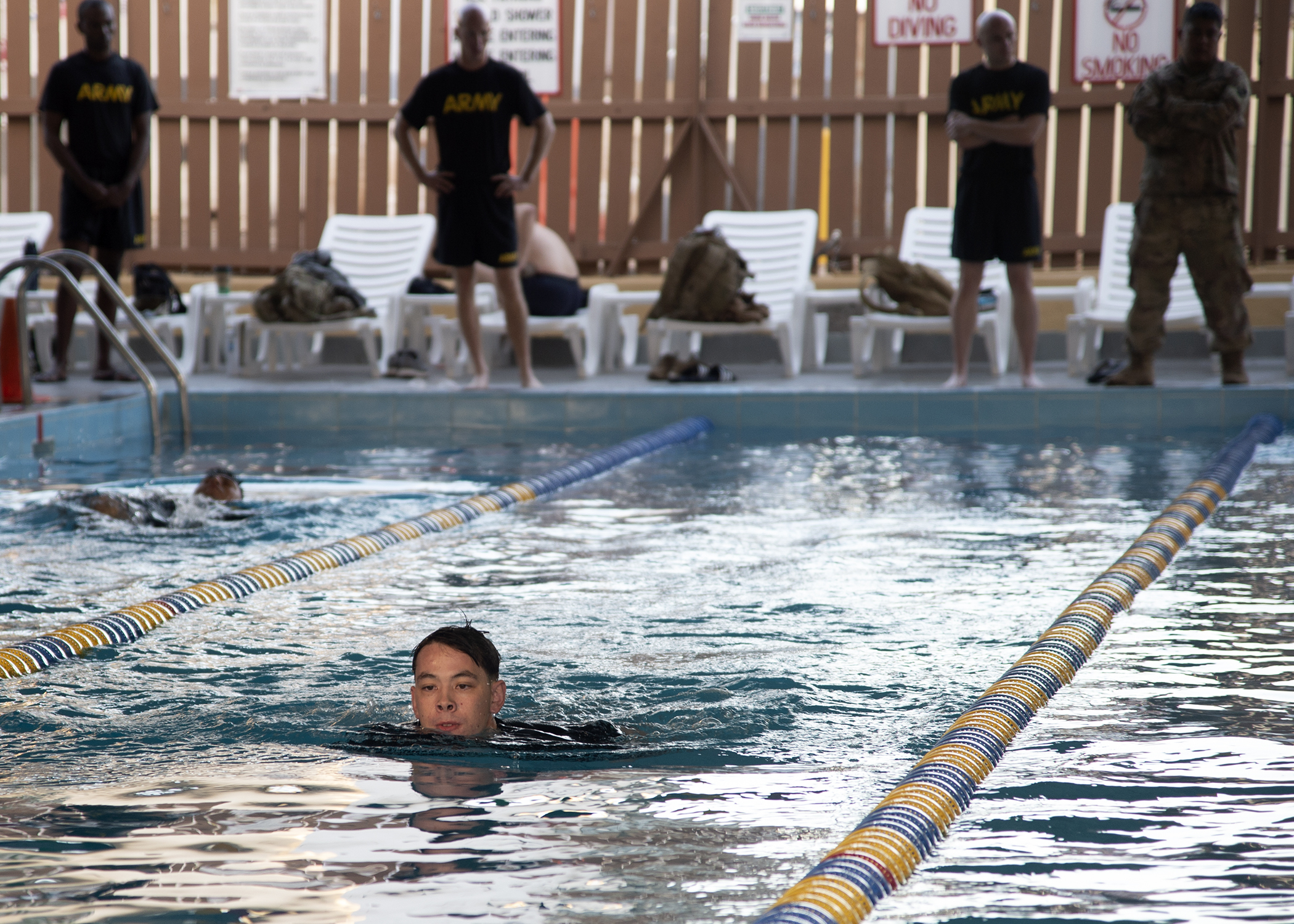 U.S. Army Pfc. Tristan Seaton, Bravo Company, 1-26 Infantry, 101st Airborne, assigned to Combined Joint Task Force-Horn of Africa (CJTF-HOA), Djibouti, competes in a swim competition for the German Armed Forces Badge (GAFB) for Military Proficiency in Djibouti, Jan. 16, 2019. The GAFB is awarded to and worn by German service members of all ranks. Allied service members may also be awarded the badge, subject to their nations' uniform regulations. (U.S. Navy photo by Mass Communication Specialist 1st Class Nick Scott)