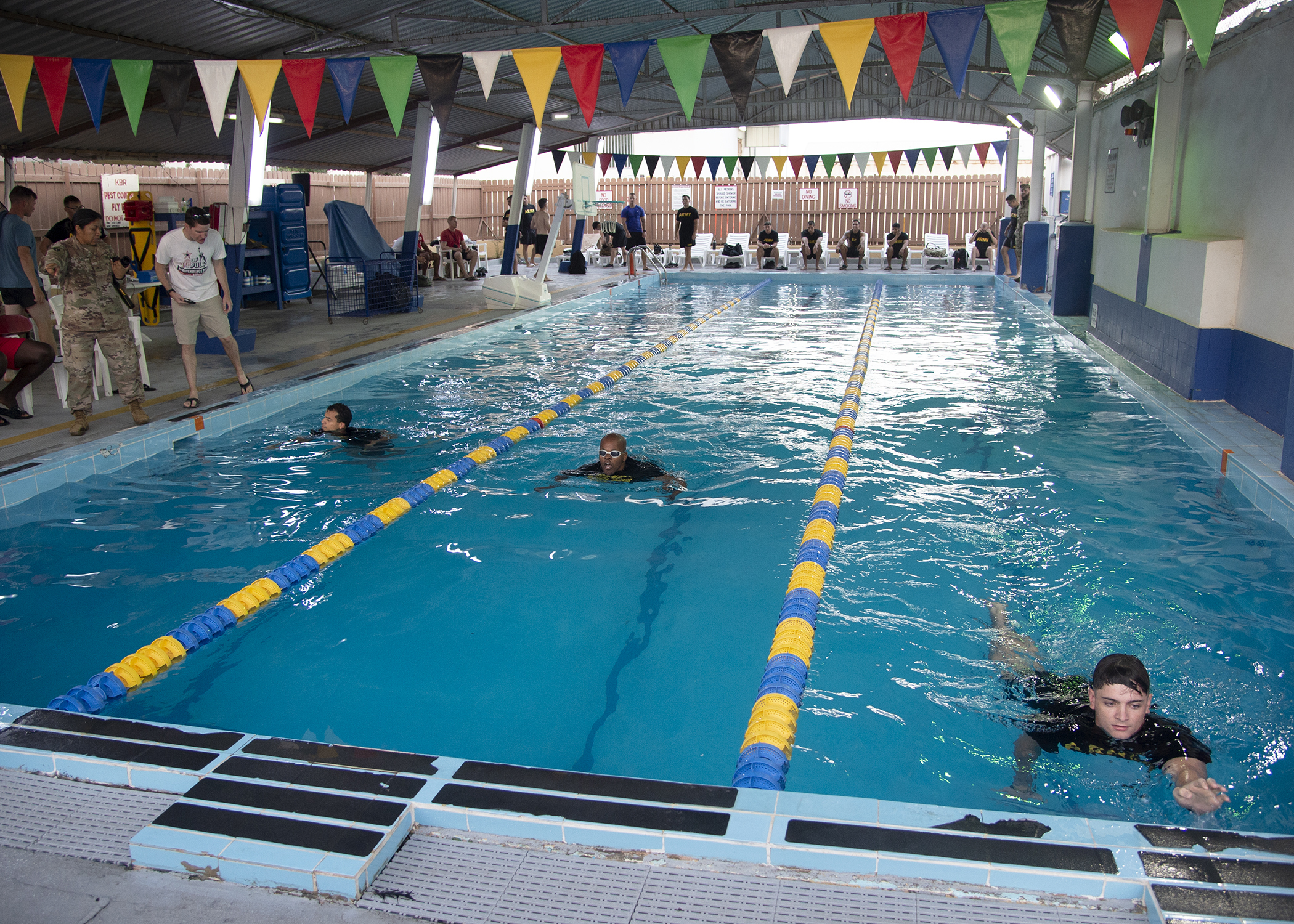 U.S. Army Soldiers from Task Force Alamo, Texas National Guard, assigned to Combined Joint Task Force-Horn of Africa (CJTF-HOA), Djibouti, compete in a swim competition for the German Armed Forces Badge (GAFB) for Military Proficiency in Djibouti, Jan. 16, 2019. The GAFB is awarded to and worn by German service members of all ranks. Allied service members may also be awarded the badge, subject to their nations' uniform regulations. (U.S. Navy photo by Mass Communication Specialist 1st Class Nick Scott)