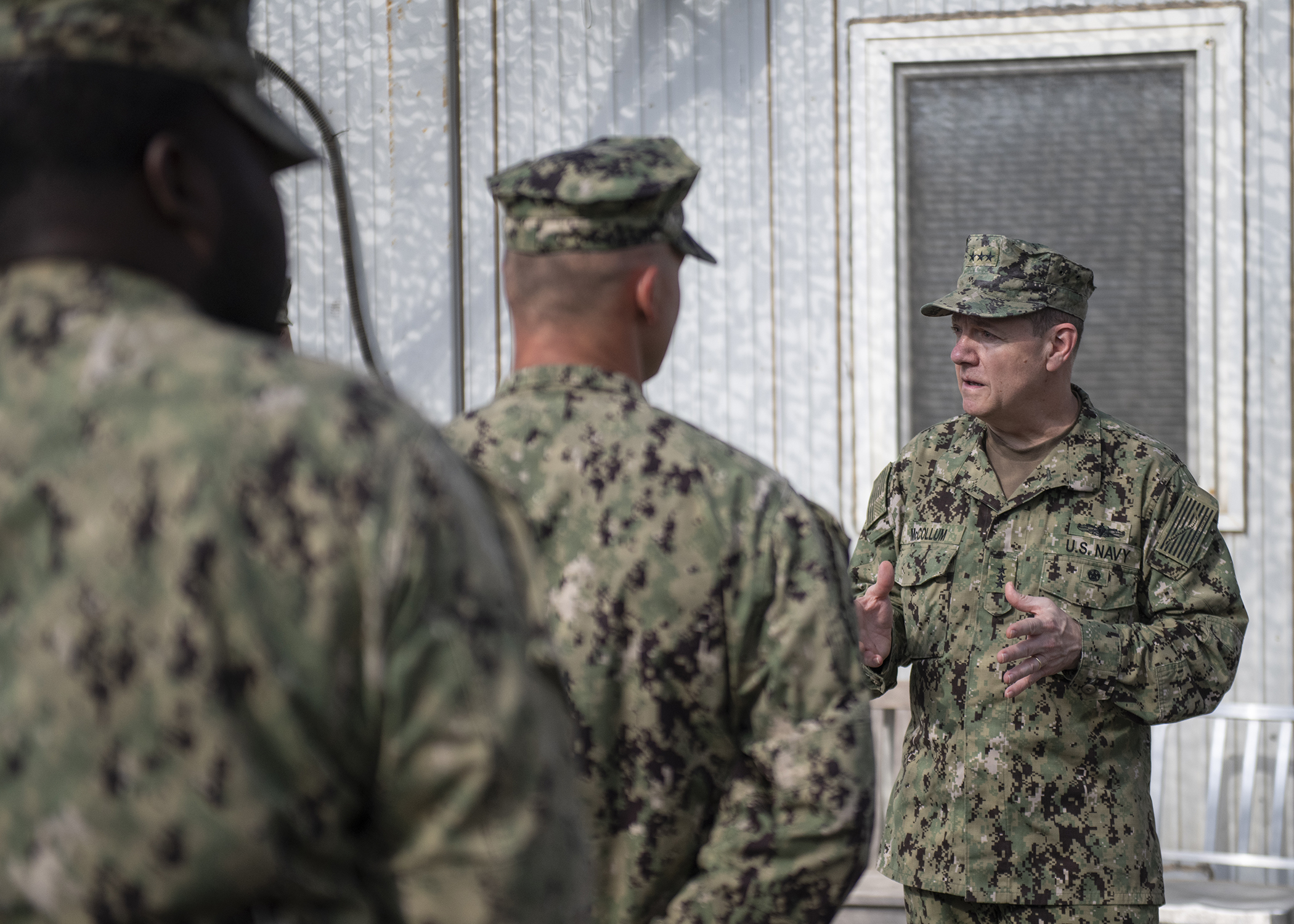 Chief of Navy Reserve Vice Adm. Luke McCollum addresses U.S. Navy Seabees, from Naval Mobile Construction Battalion 1, assigned to Combined Joint Task Force - Horn of Africa, while visiting Camp Lemonnier, Djibouti, Feb. 3, 2019. McCollum visited as part of a tour of Reserve units to answer questions, discuss leadership initiatives and interact with local Sailors. (U.S. Air Force photo by Tech. Sgt. Shawn Nickel)