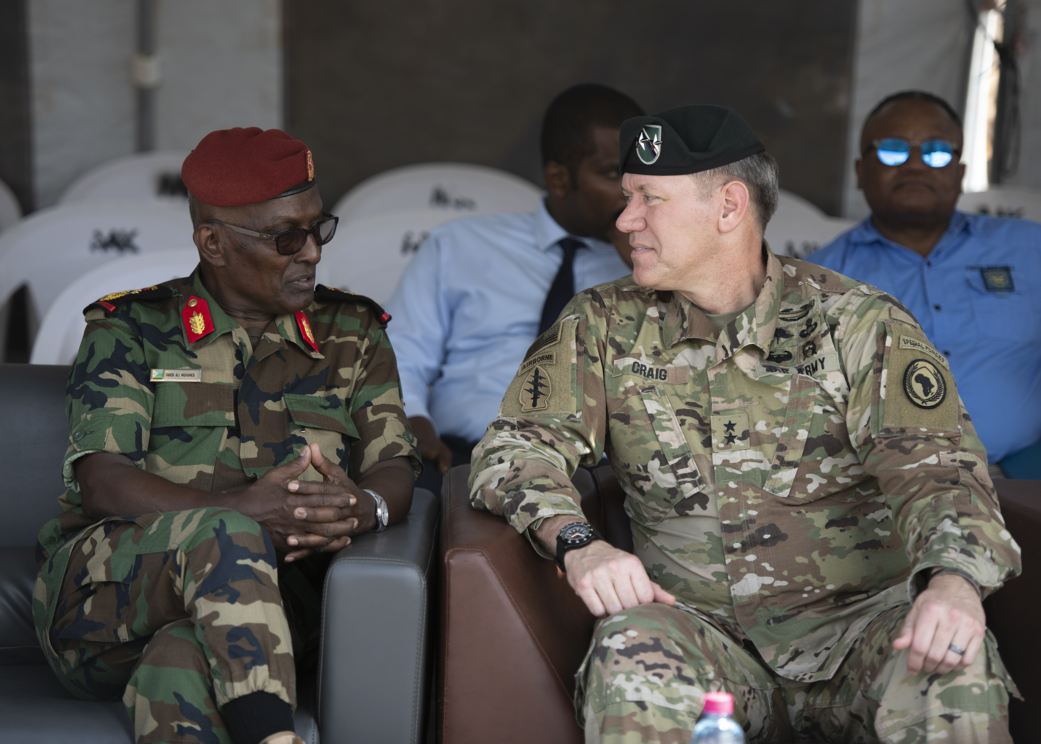 U.S. Army Maj. Gen. James D. Craig, commanding general, Combined Joint Task Force-Horn of Africa (CJTF-HOA), talks to a Djiboutian military officials during the Ali Oune Medical Clinic ribbon cutting ceremony in Ali Oune, Djibouti, Jan. 31, 2019. The clinic, which U.S. Navy Seabees from Naval Mobile Construction Battalion 1, assigned to CJTF-HOA, have been working to complete for five months, is intended to enhance the Ministry of Health for Djibouti's ability to provide basic medical, birth and after care to the Ali Oune village and its more than 1,000 residents and rural neighbors. (U.S. Air Force photo by Tech. Sgt. Shawn Nickel)