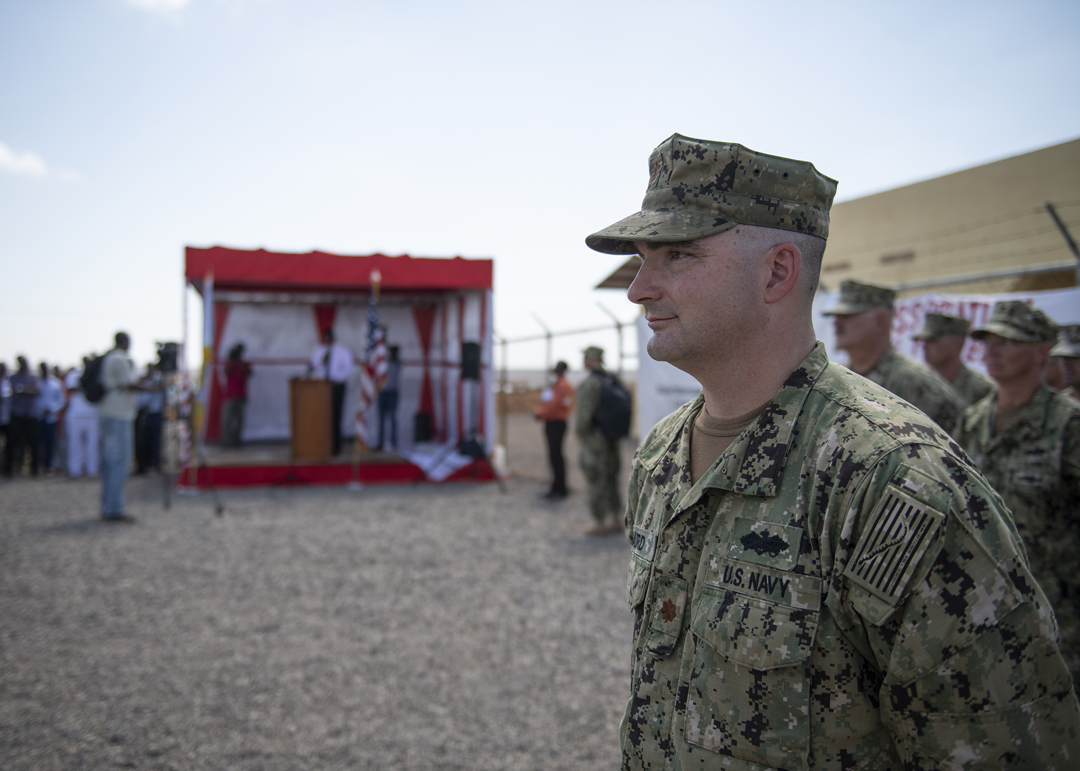 U.S. Navy Seabee Lt. Cmdr. Matthew Baird, detail officer in charge, Naval Mobile Construction Battalion 1, assigned to Combined Joint Task Force-Horn of Africa (CJTF-HOA), leads a formation during the Ali Oune Medical Clinic ribbon cutting ceremony in Ali Oune, Djibouti, Jan. 31, 2019. The clinic, which the Seabees have worked on for five months, is intended to enhance the Ministry of Health for Djibouti's ability to provide basic medical, birth and after care to the Ali Oune village and its more than 1,000 residents and rural neighbors. (U.S. Air Force photo by Tech. Sgt. Shawn Nickel)