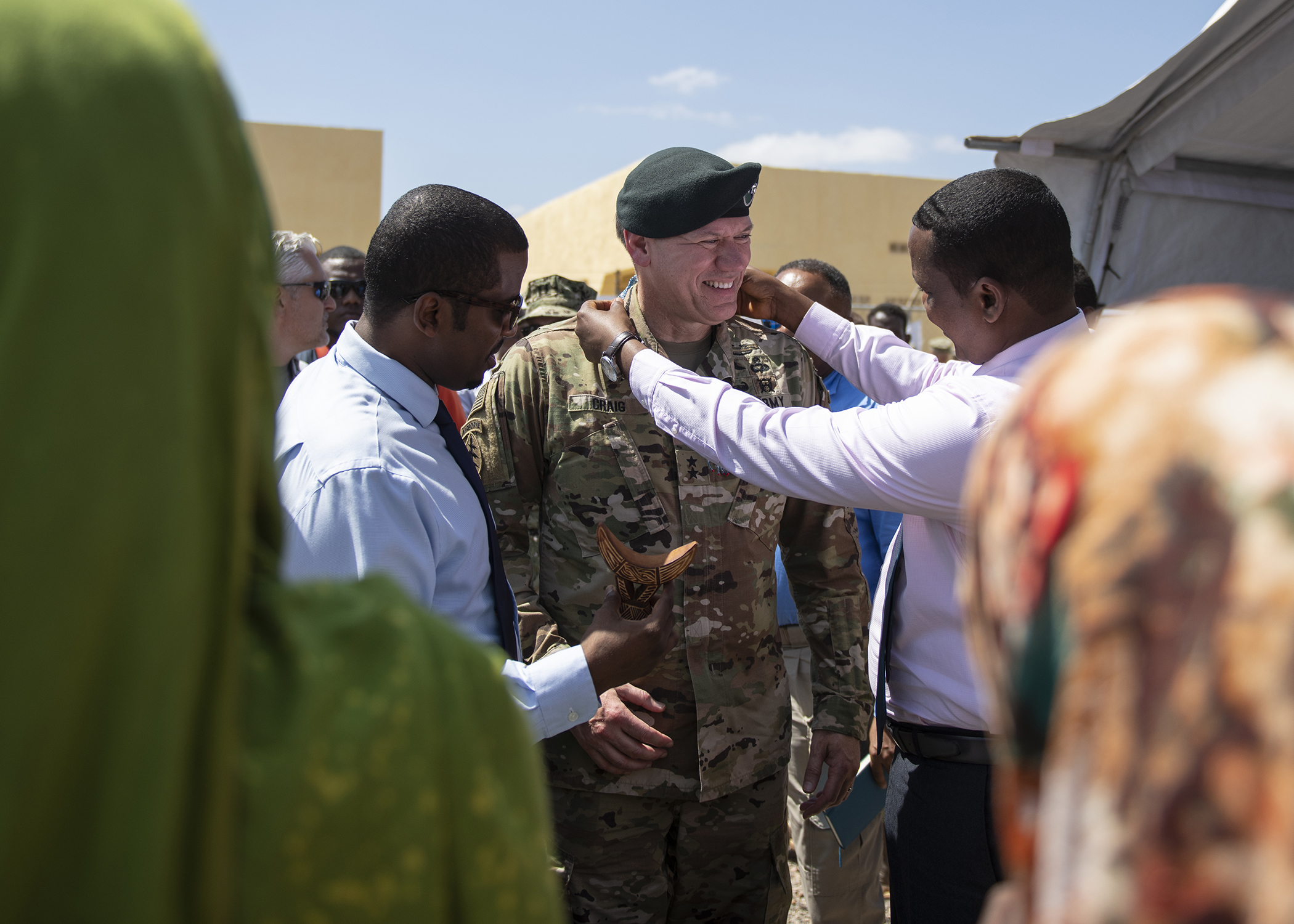 U.S. Army Maj. Gen. James D. Craig, commanding general, Combined Joint Task Force-Horn of Africa (CJTF-HOA), receives a gift from Djiboutian government officials during the Ali Oune Medical Clinic ribbon cutting ceremony in Ali Oune, Djibouti, Jan. 31, 2019. The clinic, which U.S. Navy Seabees from Naval Mobile Construction Battalion 1, assigned to CJTF-HOA, have been working to complete for five months, is intended to enhance the Ministry of Health for Djibouti's ability to provide basic medical, birth and after care to the Ali Oune village and its more than 1,000 residents and rural neighbors. (U.S. Air Force photo by Tech. Sgt. Shawn Nickel)