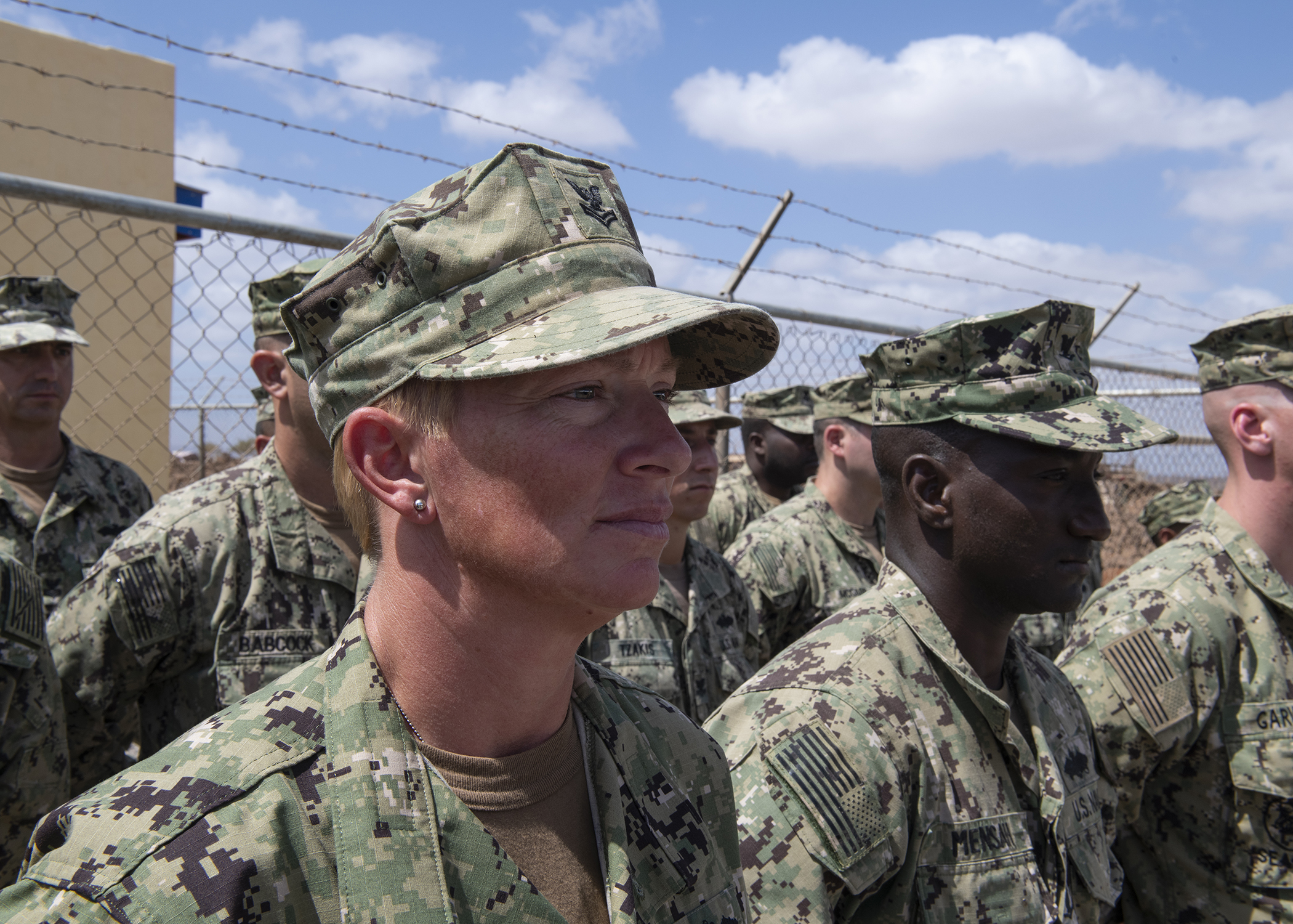 U.S. Navy Petty Officer 1st Class Carroll Bennett, a Seabee from Naval Mobile Construction Battalion 1, assigned to Combined Joint Task Force-Horn of Africa, stands in formation during the Ali Oune Medical Clinic ribbon cutting ceremony in Ali Oune, Djibouti, Jan. 31, 2019. The clinic, which the Seabees have worked on for five months, is intended to enhance the Ministry of Health for Djibouti's ability to provide basic medical, birth and after care to the Ali Oune village and its more than 1,000 residents and rural neighbors. (U.S. Air Force photo by Tech. Sgt. Shawn Nickel)