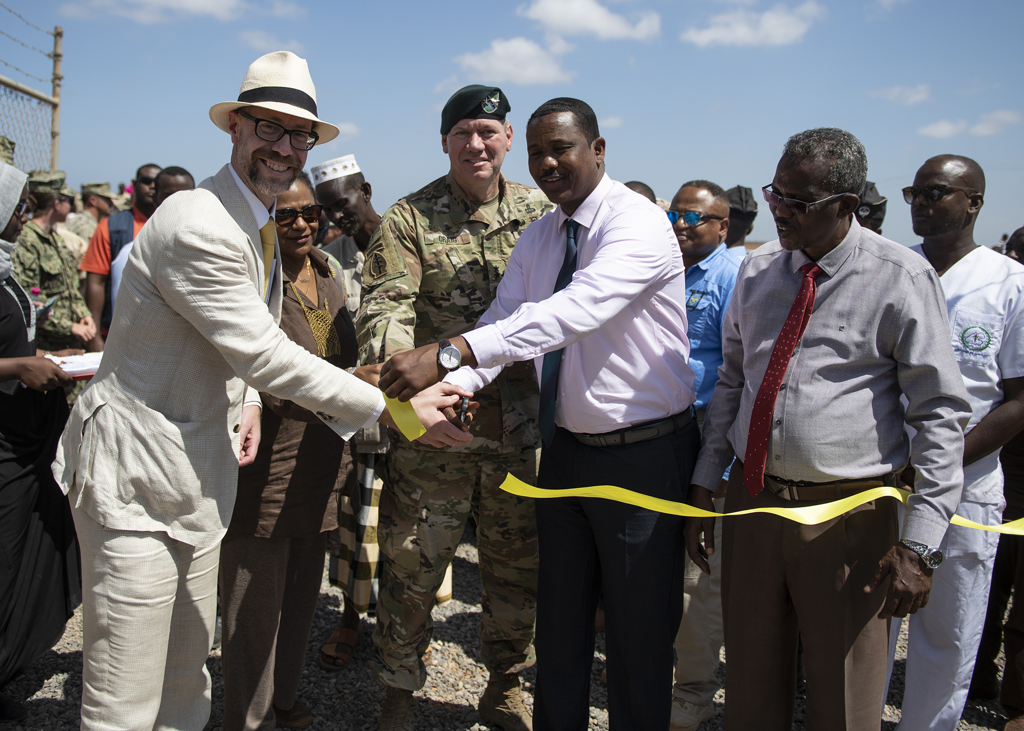 U.S. Djibouti Embassy officials, Combined Joint Task Force-Horn of Africa leadership, and Djiboutian government leaders cut the ribbon for the Ali Oune Medical Clinic during a ceremony in Ali Oune, Djibouti, Jan. 31, 2019. The clinic, which U.S. Navy Seabees from Naval Mobile Construction Battalion 1, assigned to CJTF-HOA, have been working to complete for five months, is intended to enhance the Ministry of Health for Djibouti's ability to provide basic medical, birth and after care to the Ali Oune village and its more than 1,000 residents and rural neighbors. (U.S. Air Force photo by Tech. Sgt. Shawn Nickel)