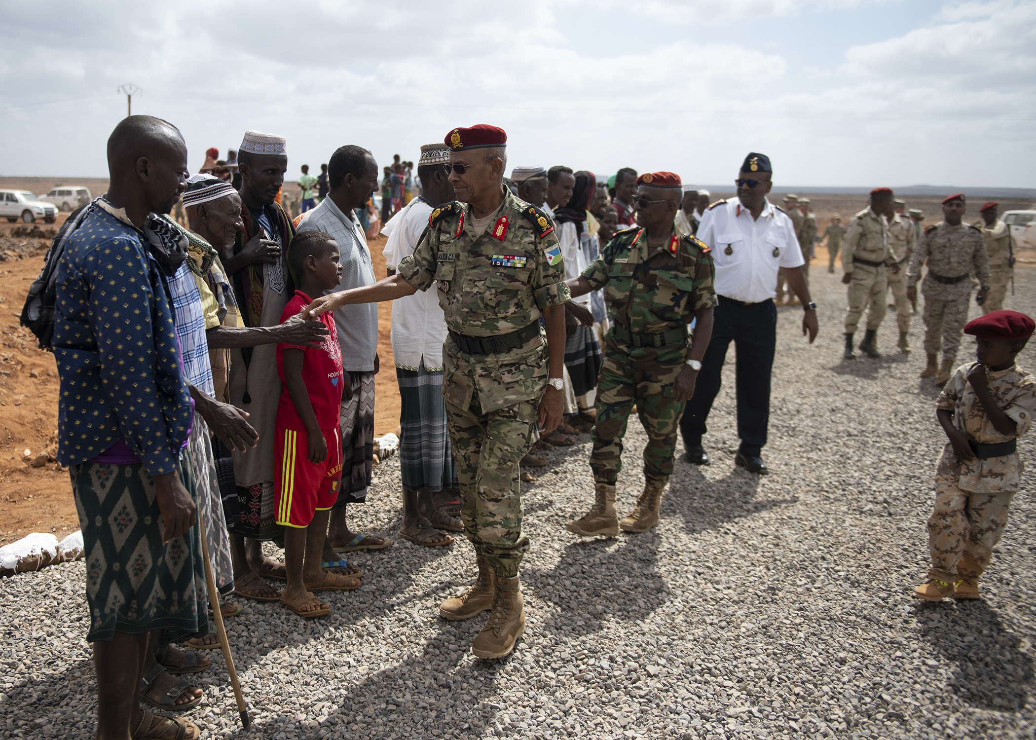 Djiboutian citizens greet military leaders during the Ali Oune Medical Clinic ribbon cutting ceremony in Ali Oune, Djibouti, Jan. 31, 2019. The clinic, which the U.S. Navy Seabees from Naval Mobile Construction Battalion 1, Combined Joint Task Force - Horn of Africa, have been working to complete for five months, is intended to enhance the Ministry of Health for Djibouti's ability to provide basic medical, birth and after care to the Ali Oune village and its more than 1,000 residents and rural neighbors. (U.S. Air Force photo by Tech. Sgt. Shawn Nickel)