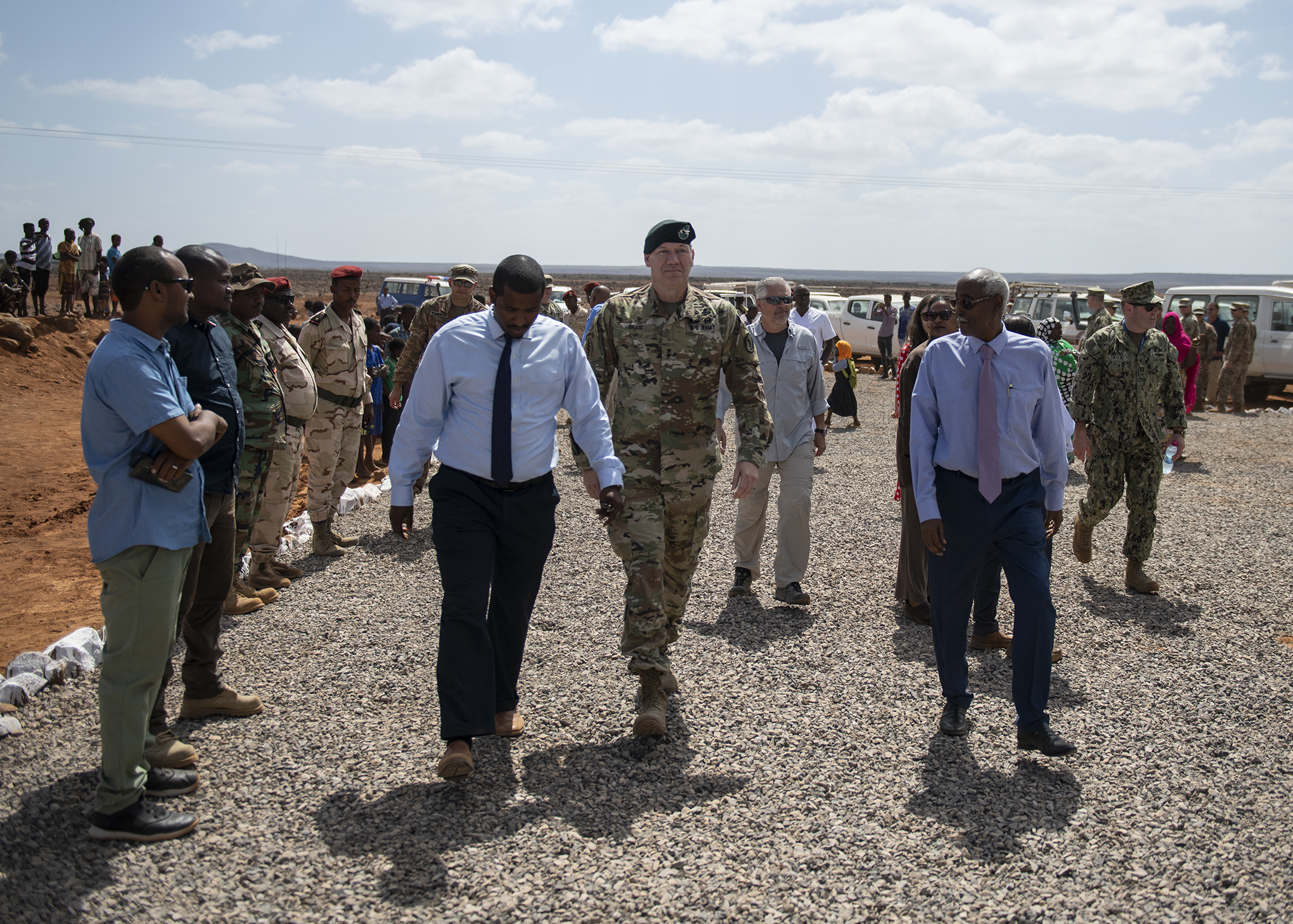 U.S. Army Maj. Gen. James D. Craig, commanding general, Combined Joint Task Force-Horn of Africa (CJTF-HOA), walks with Djiboutian government officials during the Ali Oune Medical Clinic ribbon cutting ceremony in Ali Oune, Djibouti, Jan. 31, 2019. The clinic, which U.S. Navy Seabees from Naval Mobile Construction Battalion 1, assigned to CJTF-HOA, have been working to complete for five months, is intended to enhance the Ministry of Health for Djibouti's ability to provide basic medical, birth and after care to the Ali Oune village and its more than 1,000 residents and rural neighbors. (U.S. Air Force photo by Tech. Sgt. Shawn Nickel)