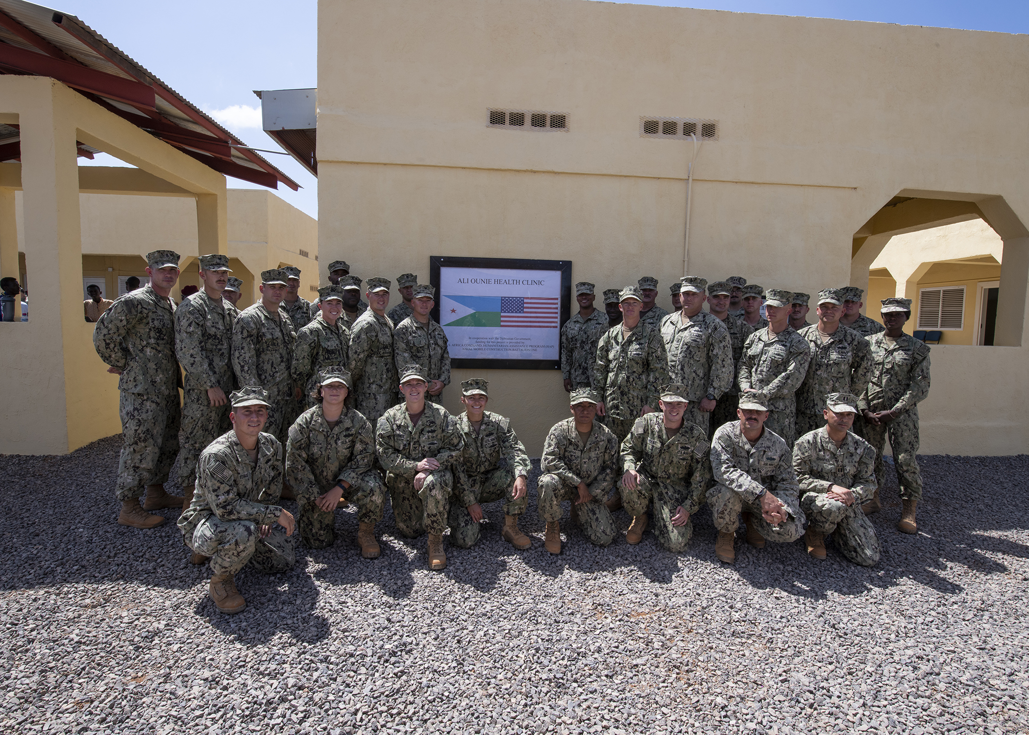 U.S. Navy Seabees from Naval Mobile Construction Battalion 1, assigned to Combined Joint Task Force-Horn of Africa, pose for a group photo during the Ali Oune Medical Clinic ribbon cutting ceremony in Ali Oune, Djibouti, Jan. 31, 2019. The clinic, which the Seabees have worked on for five months, is intended to enhance the Ministry of Health for Djibouti's ability to provide basic medical, birth and after care to the Ali Oune village and its more than 1,000 residents and rural neighbors. (U.S. Air Force photo by Tech. Sgt. Shawn Nickel)