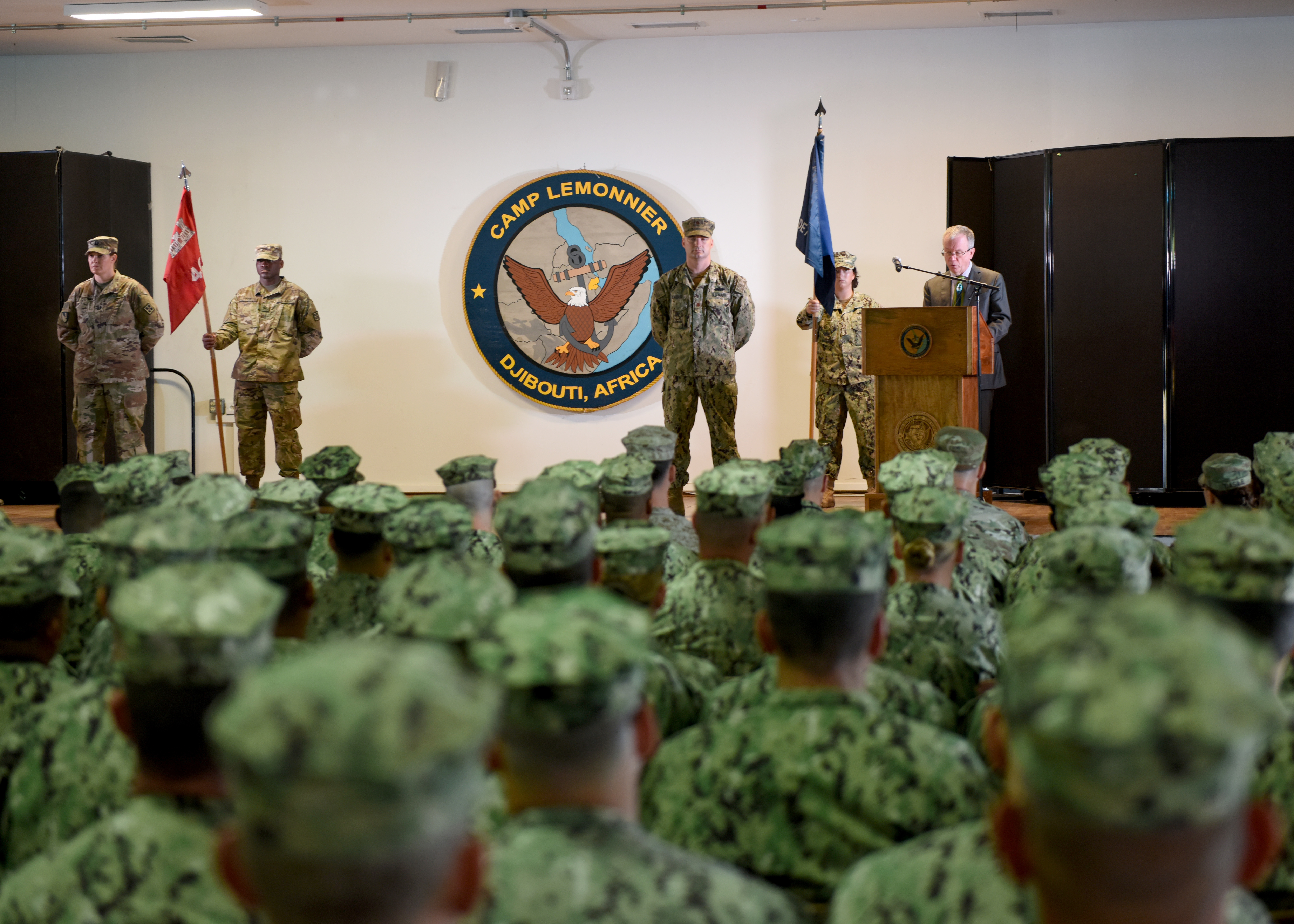 U.S. Ambassador to Djibouti Larry Andre', gives a speech during a transfer-of-authority ceremony at Camp Lemonnier, Djibouti, Feb. 11, 2019. The Naval Mobile Construction Battalion 1, assigned to Combined Joint Task Force-Horn of Africa (CJTF-HOA), transferred authority of building and improving facilities on base and in the combined joint operations area and area of interest to the U.S. Army 465th Engineer Company, 926th Engineer Battalion, 926th Engineer Brigade, 412th Theater Engineer Command, based in Birmingham, Alabama, assigned to CJTF-HOA. (U.S. Air Force photo by Staff Sgt. Franklin R. Ramos)